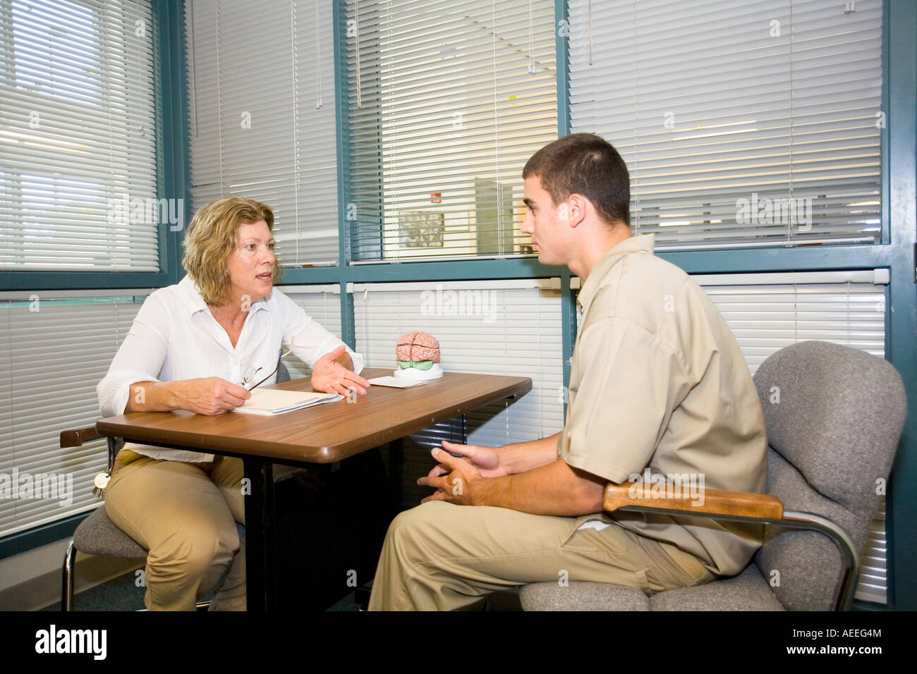 mental health counselor talking to juvenile inmate at the nebraska
