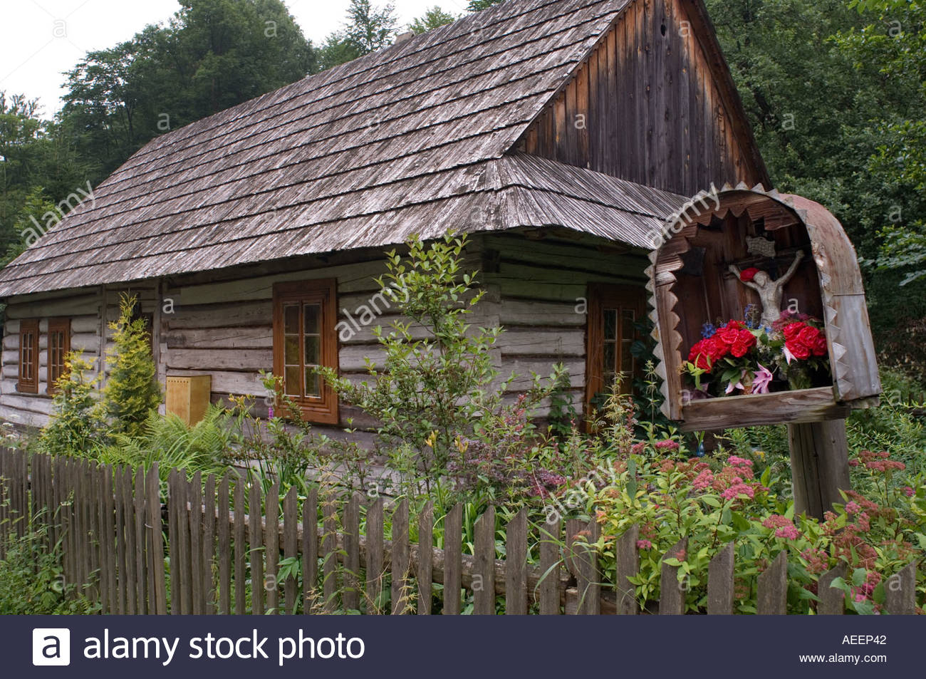 Catholic shrine outside a traditional wooden house in the polish stock photo royalty free image - Traditional polish houses wood mastership ...
