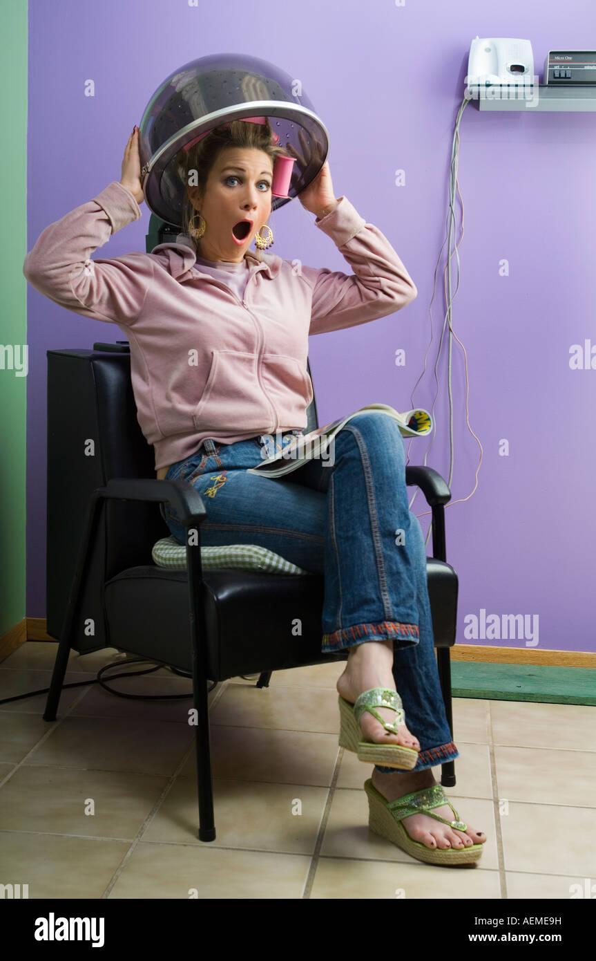 Sit Under Hair Dryer ~ Young woman sitting under hairdryer hot girls wallpaper