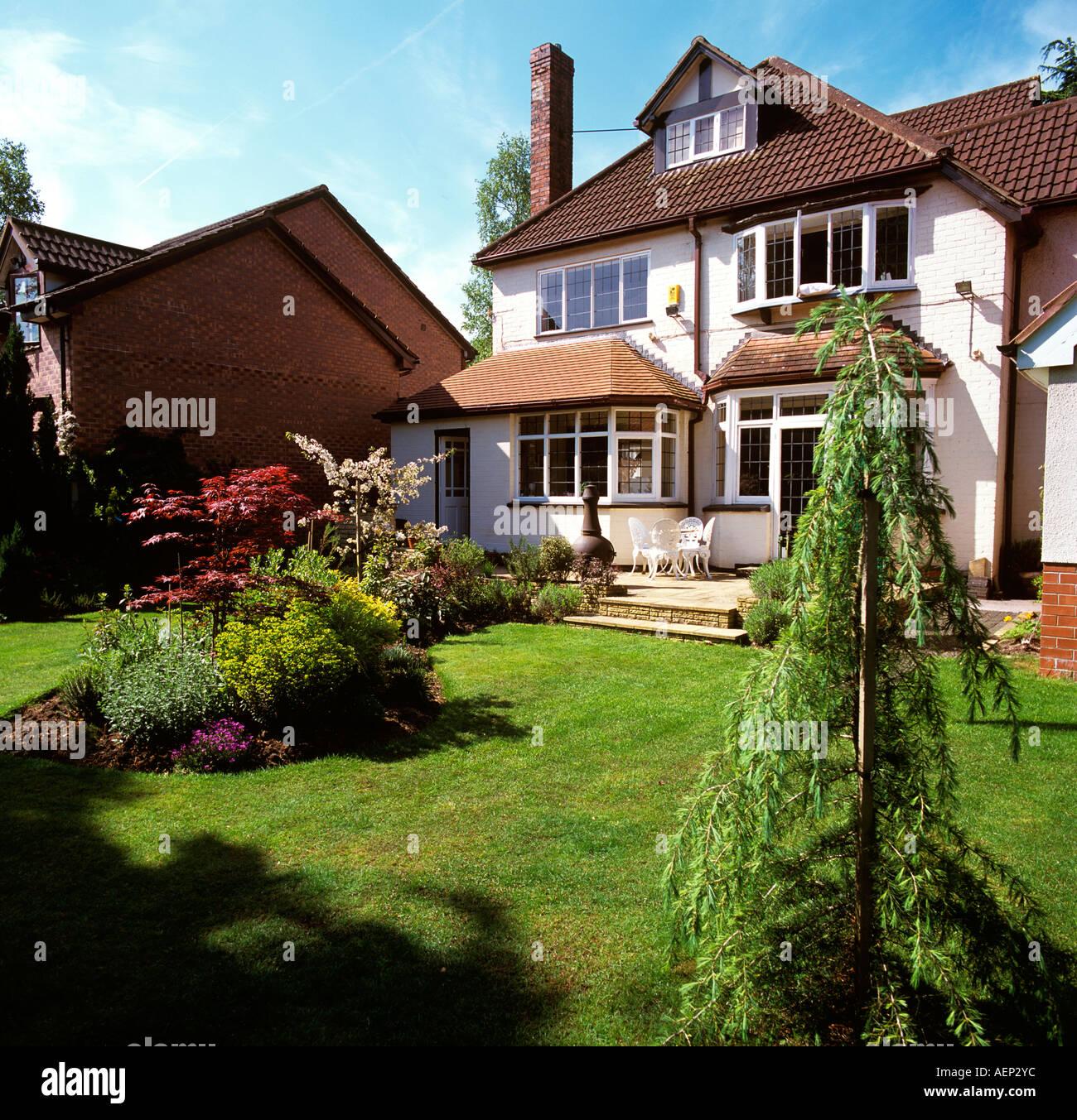 Home Improvements Back Garden Of Large Detached House