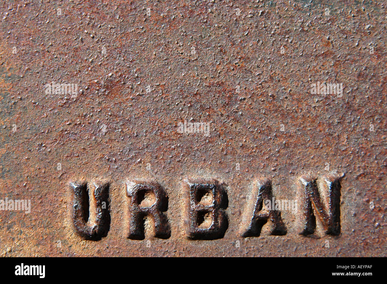 rusted metal with the word urban stamped in it Stock Photo ...