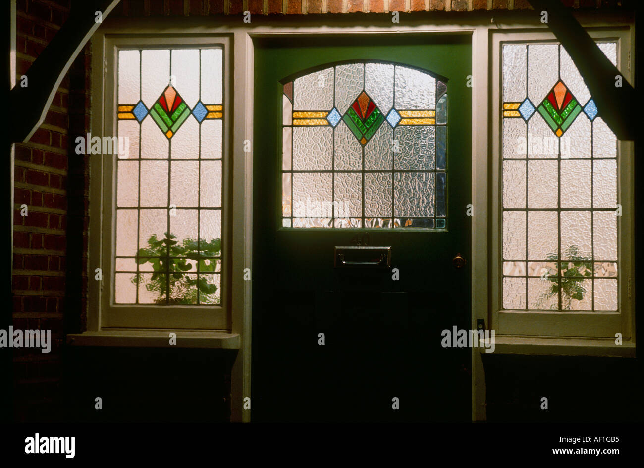 Art deco stained glass front door at night british housing for Art glass windows and doors