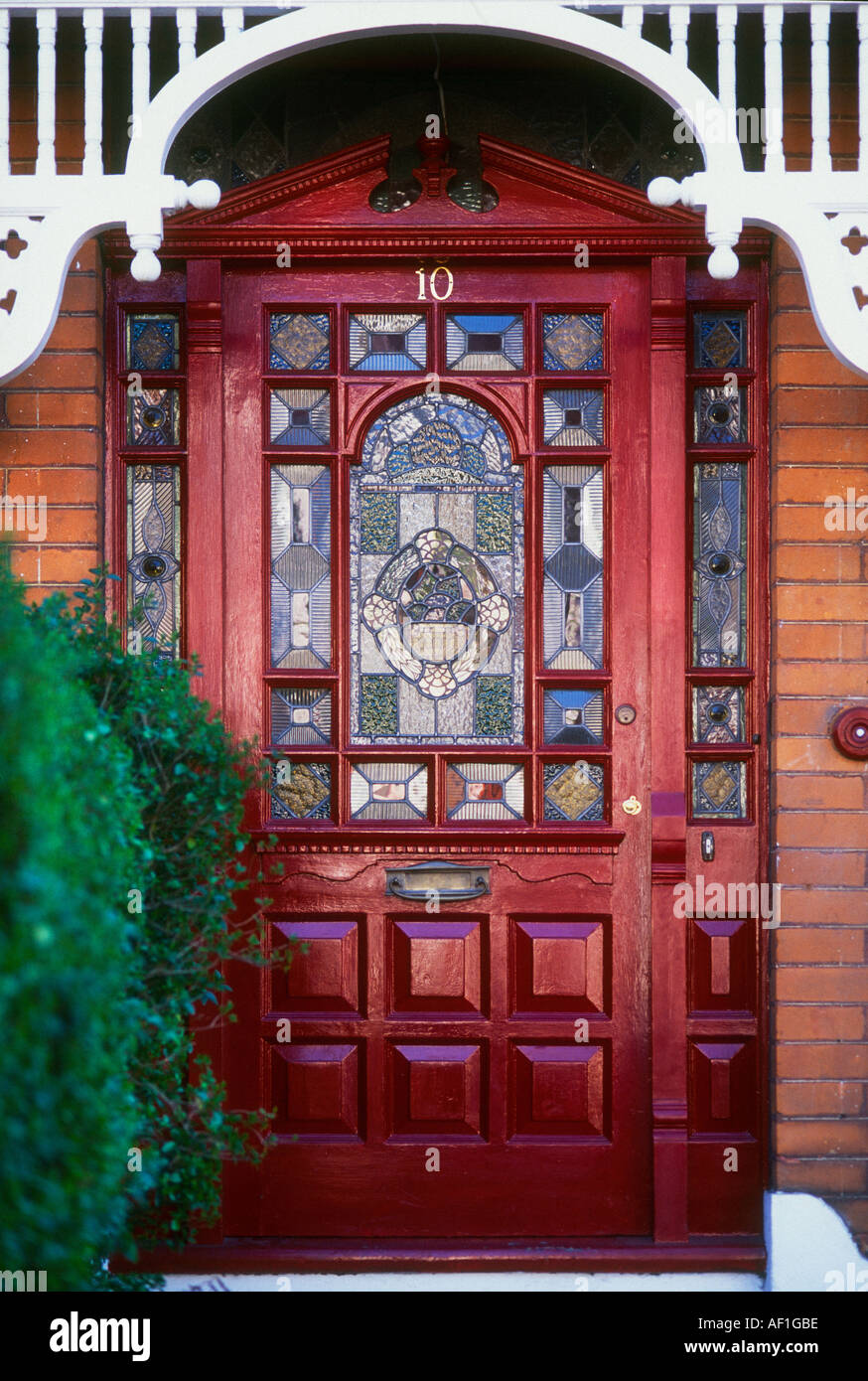 Exterior stained glass red front door british housing london stock photo royalty free image for Stained glass exterior front doors