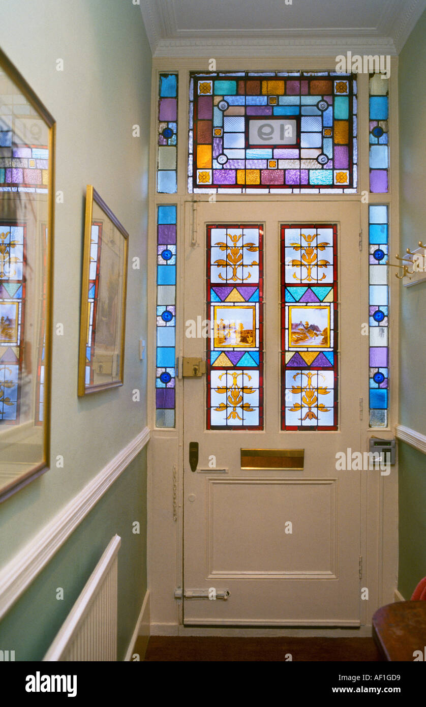 hallway interior of victorian house with stained glass front door