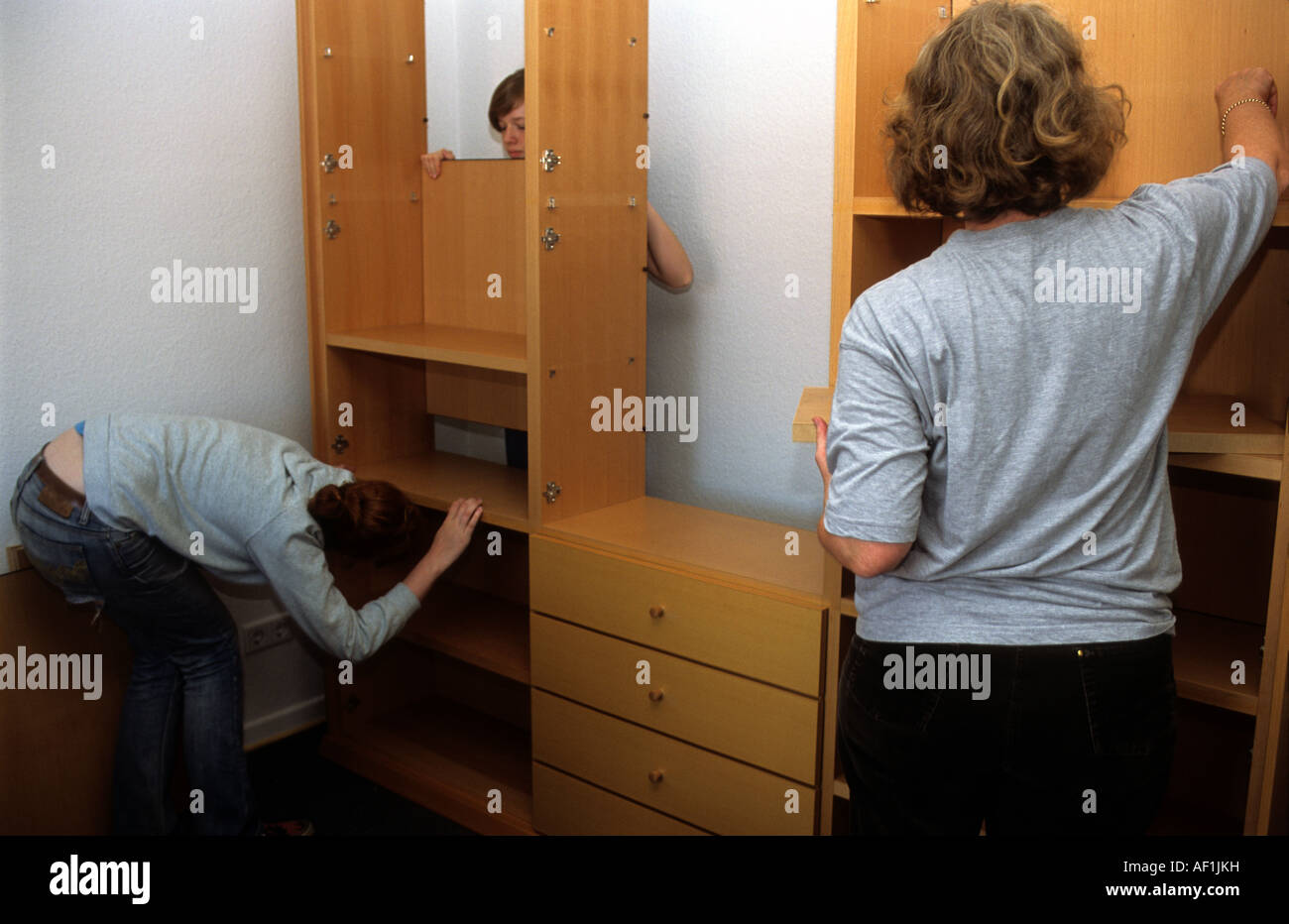 flat pack furniture. Family Assembling Flat Pack Furniture At Their Home In Solingen, North Rhine-Westphalia, Germany D