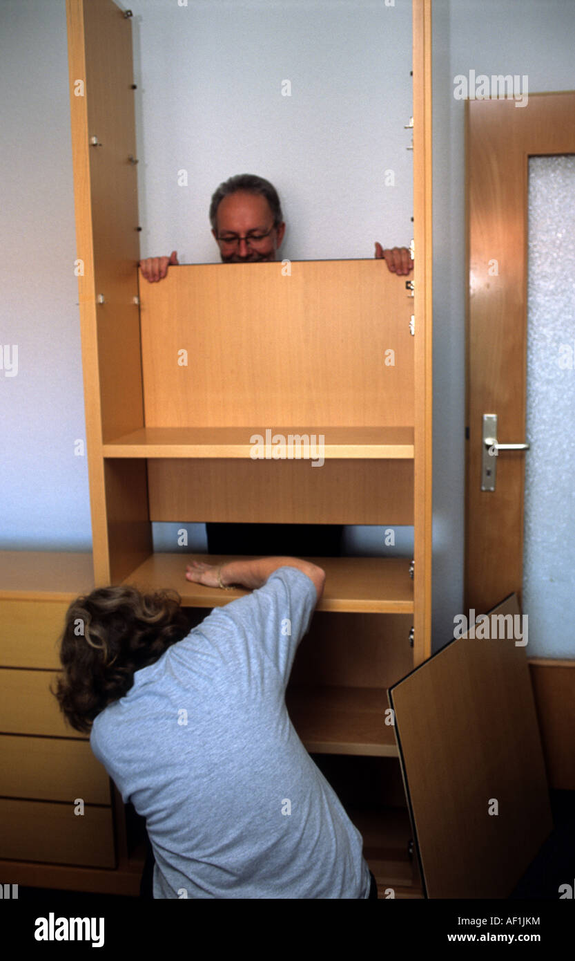 Couple assembling flat pack furniture at their home in solingen stock photo royalty free image - Diy tips assembling flat pack furniture ...