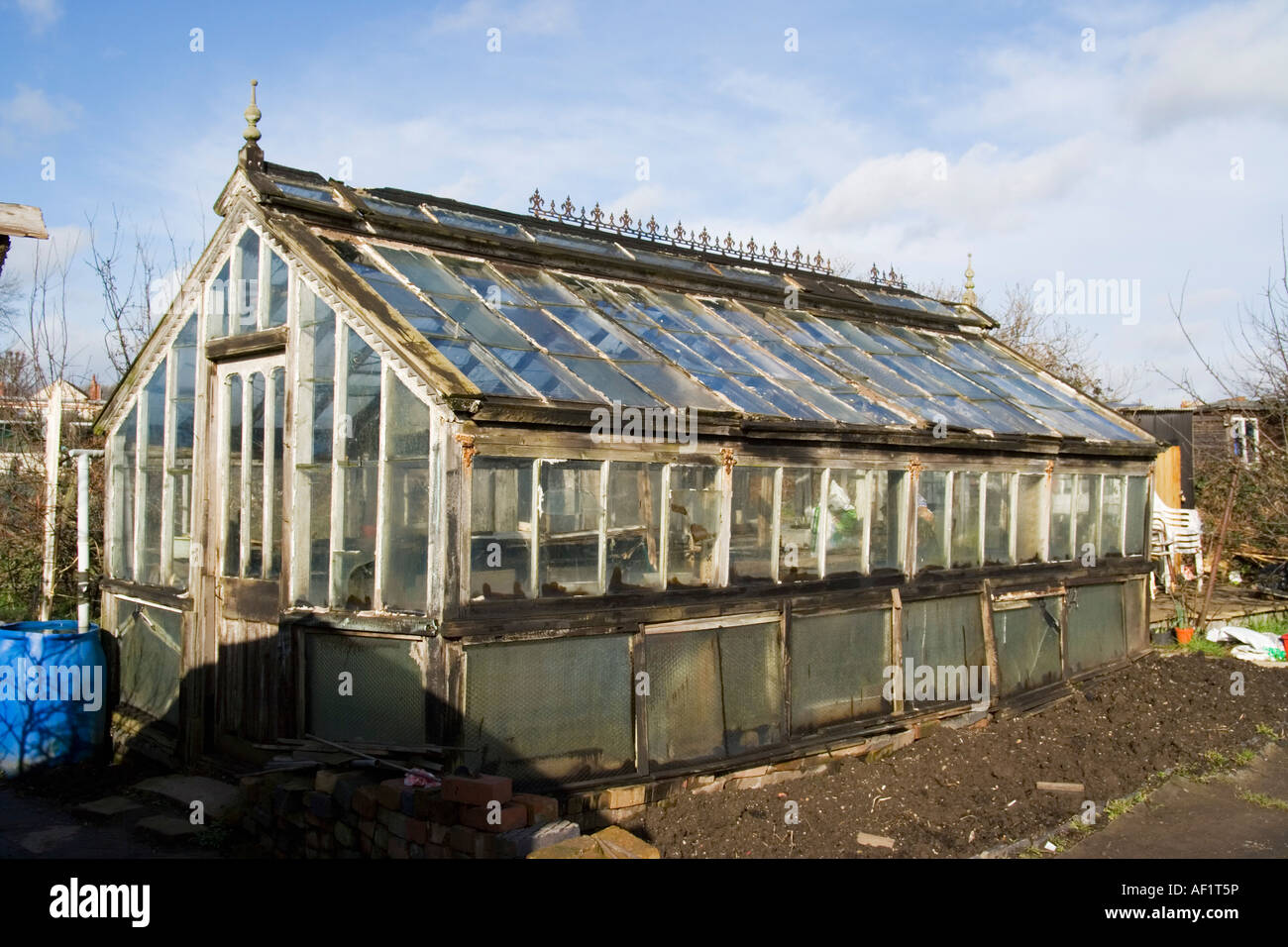 Very old victorian style wooden greenhouse stock photo for Victorian style greenhouse