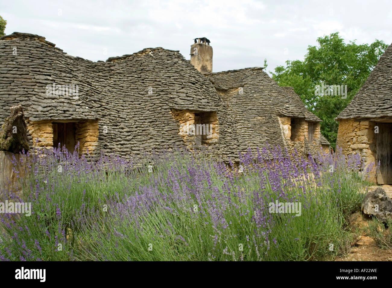 The stone age dwellings at les cabanes du breuil dordogne france stock photo - Les cabanes du trappeur ...