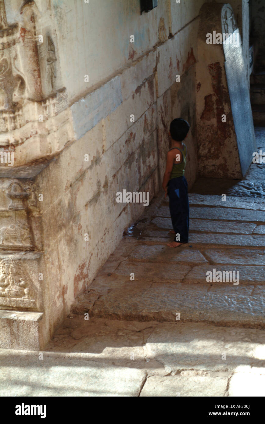 India child Pissing A young Indian boy takes a pee in the Temple in Hampi, Karnataka, Southern  India.