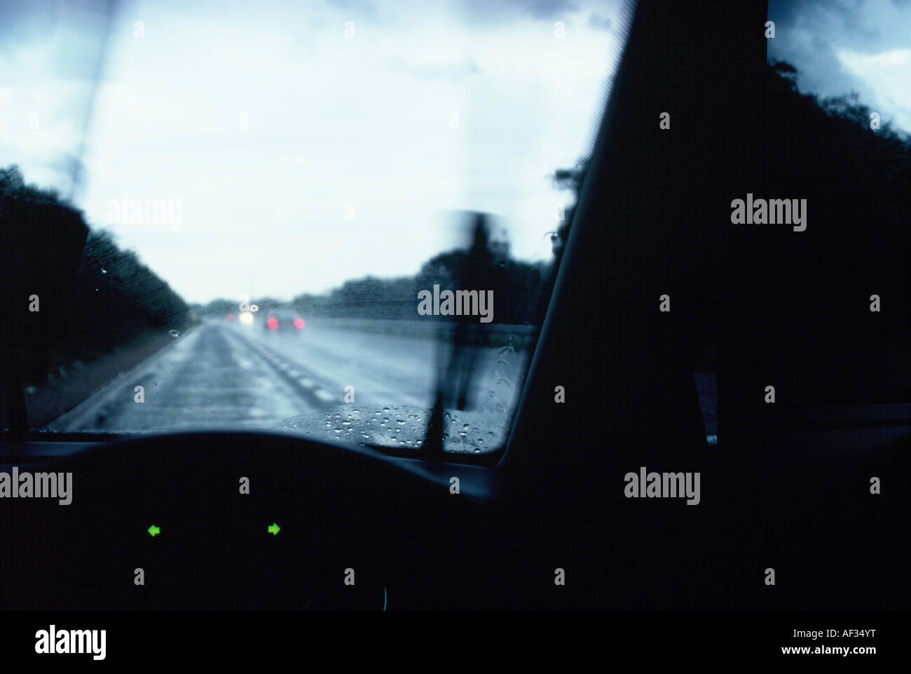 drivers eye view from the interior of a car parked in the rain on the stock photo royalty free. Black Bedroom Furniture Sets. Home Design Ideas