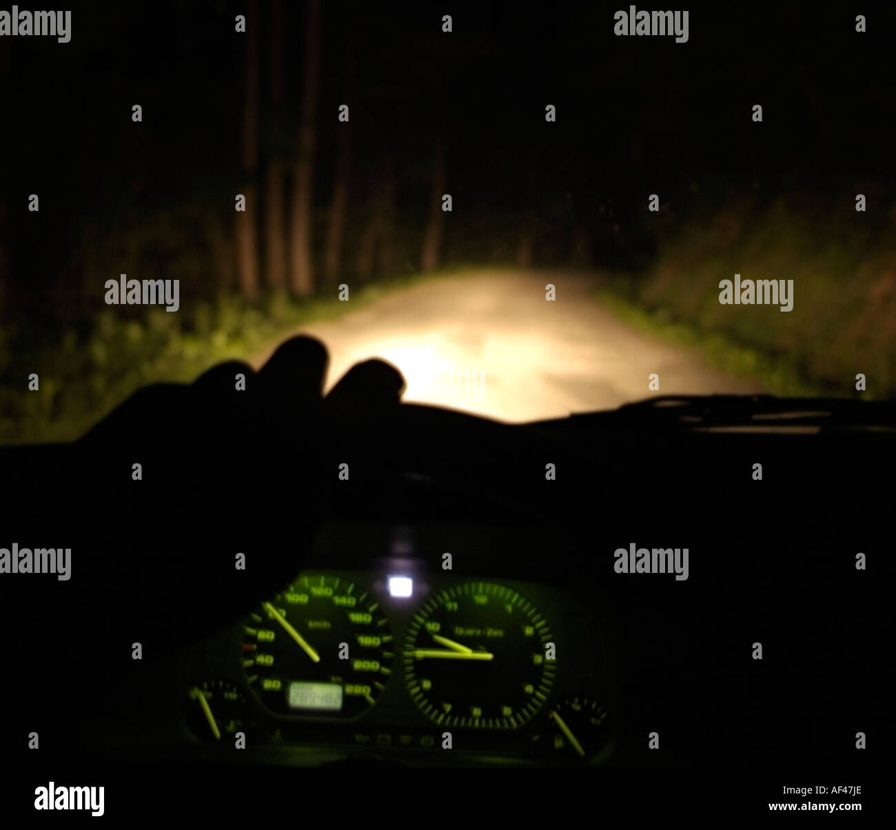 drivers view from the interior of a car driving at night along an stock photo royalty free. Black Bedroom Furniture Sets. Home Design Ideas