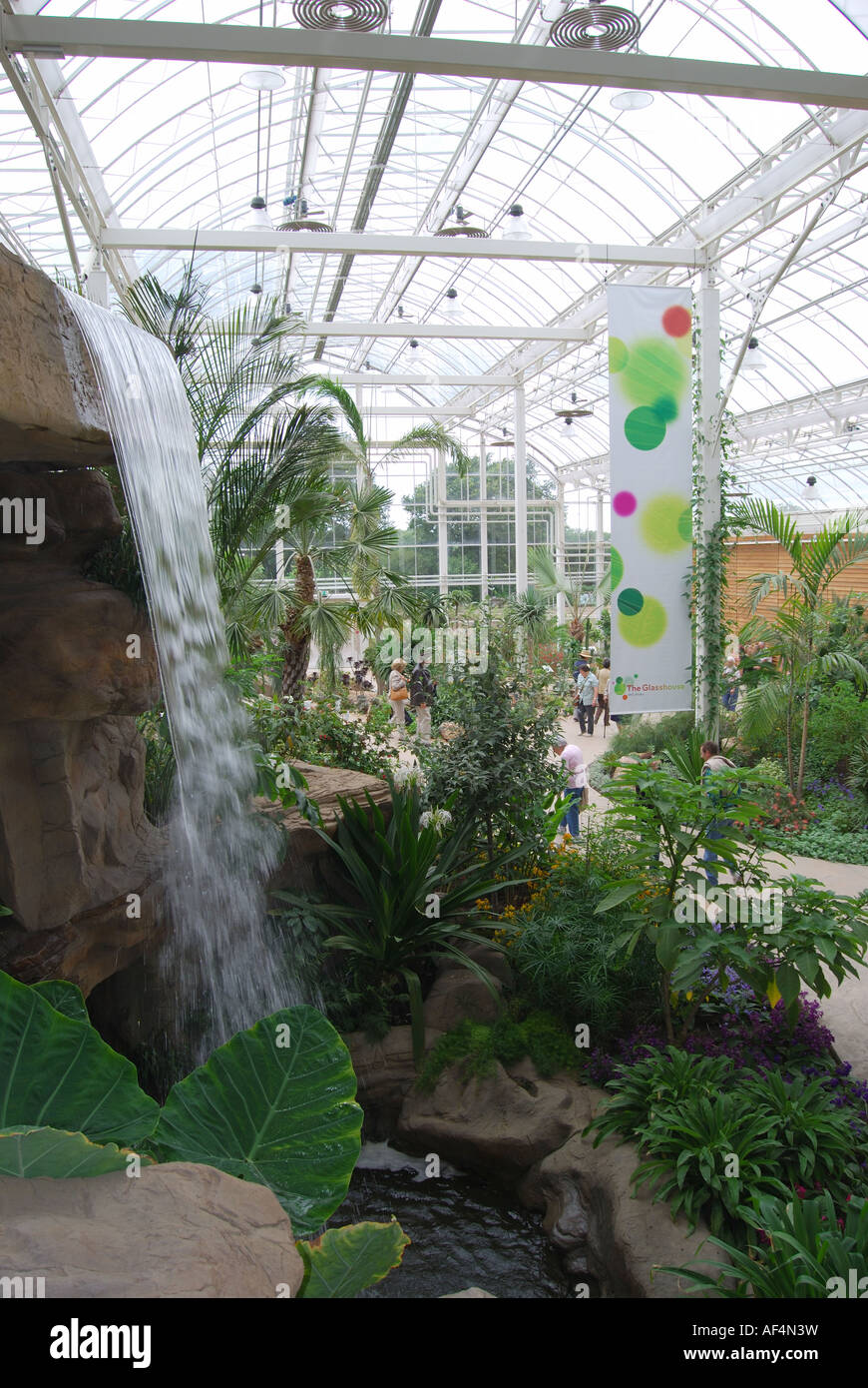 Indoor plants and waterfall The Glasshouse RHS Wisley Gardens