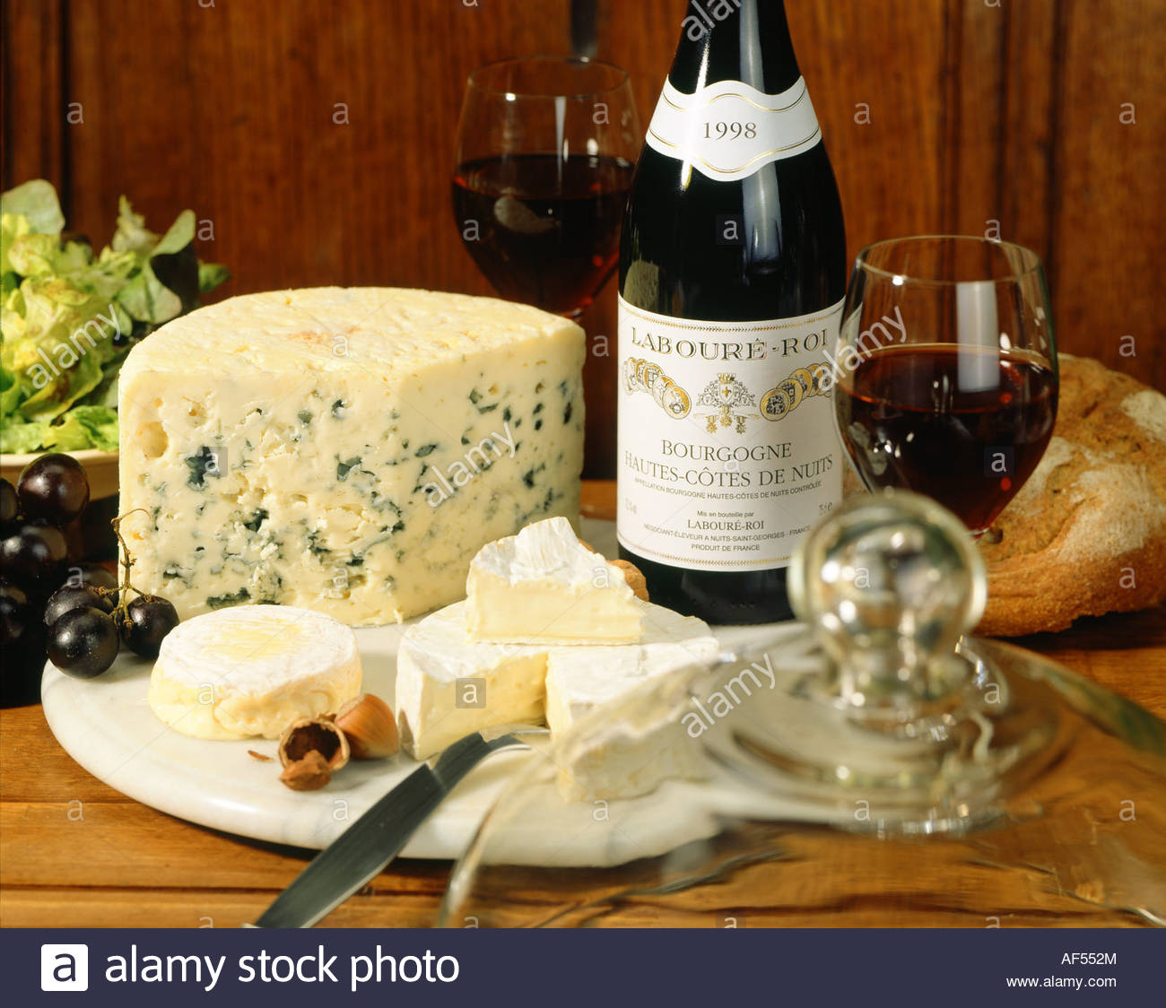 Cheese platter with French cheese and bottle of red wine ...