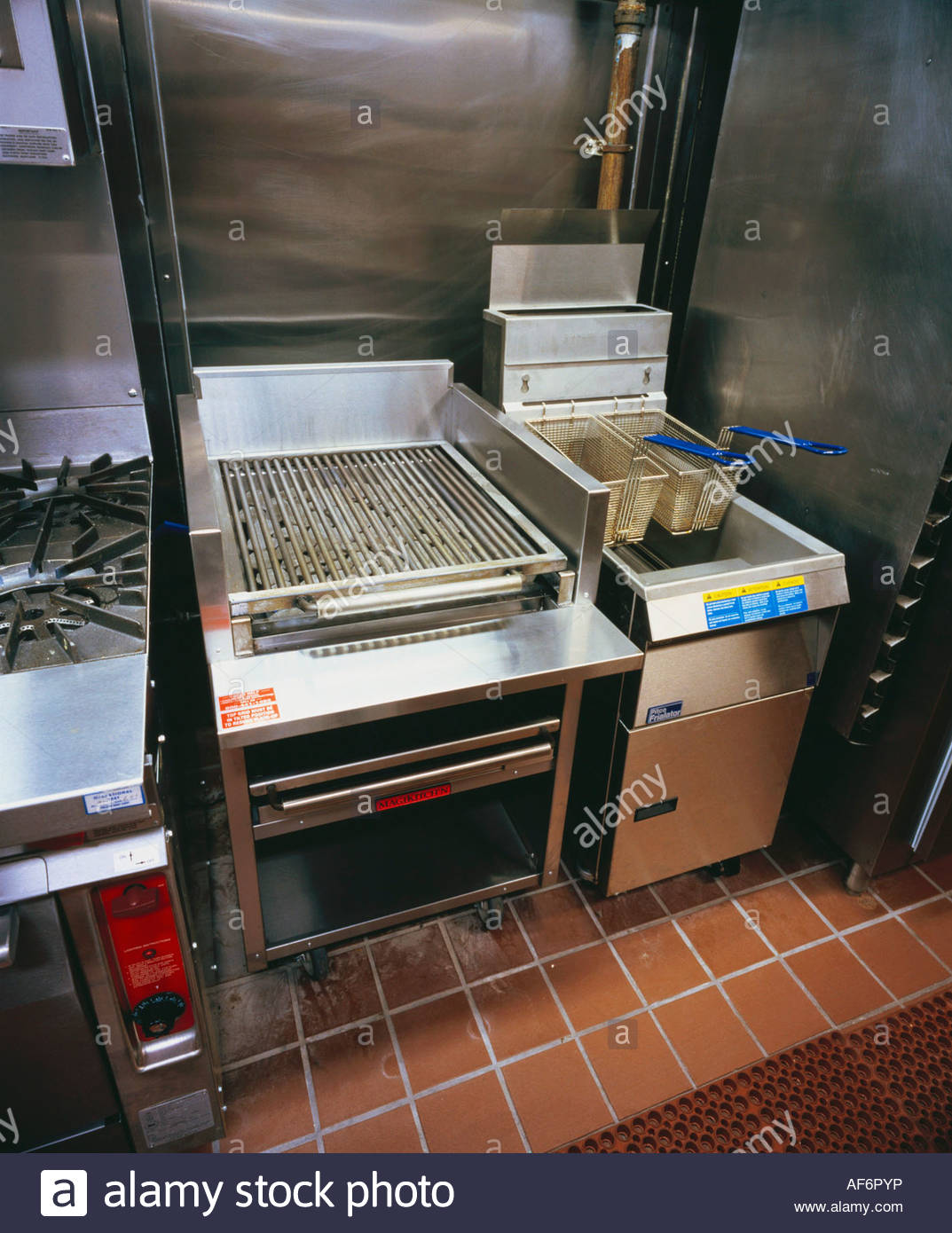 Restaurant Kitchen Grill grill and deep fryer in a restaurant kitchen stock photo, royalty