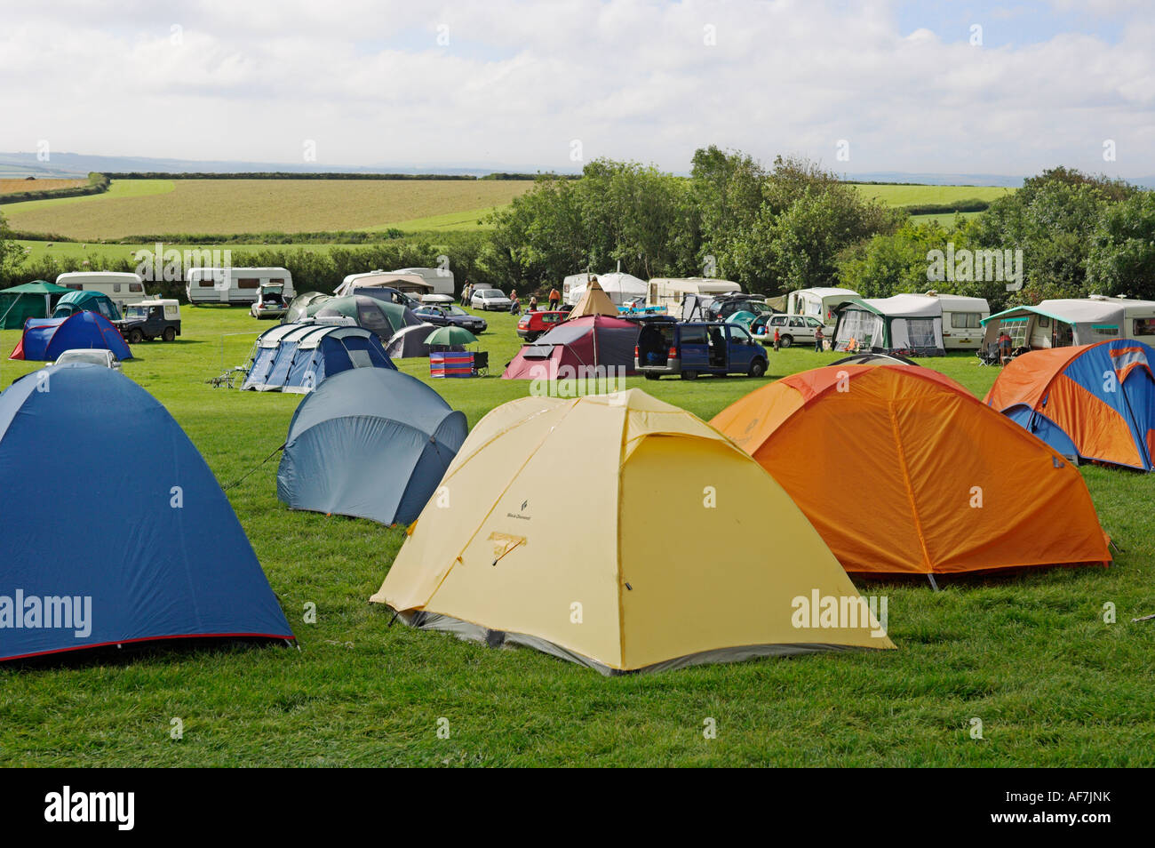 British c&site with tents and caravans in field North Cornwall west country near Bude England & British campsite with tents and caravans in field North Cornwall ...