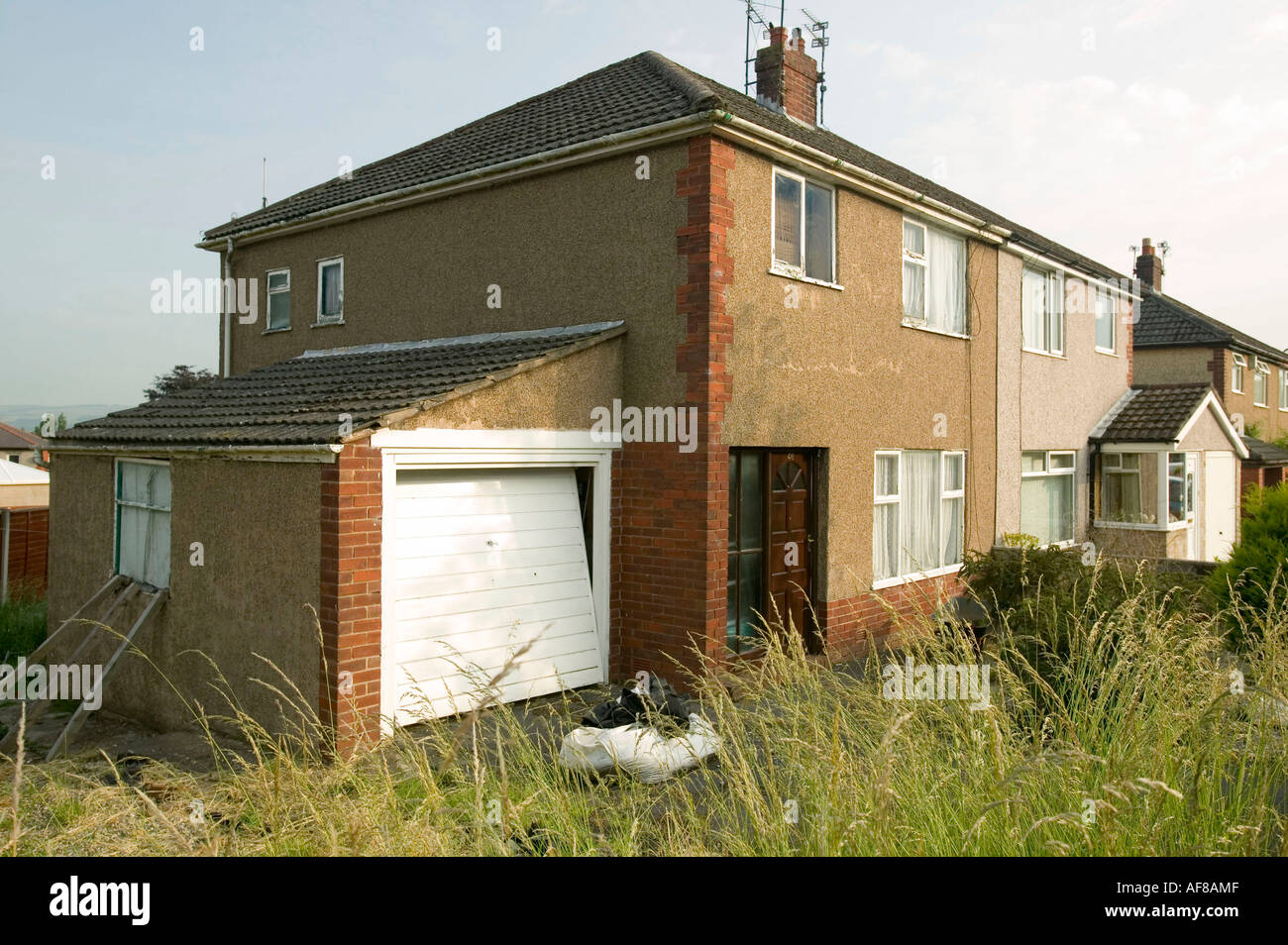 Semi Detached House a run down , neglected semi detached house next to a well loooked