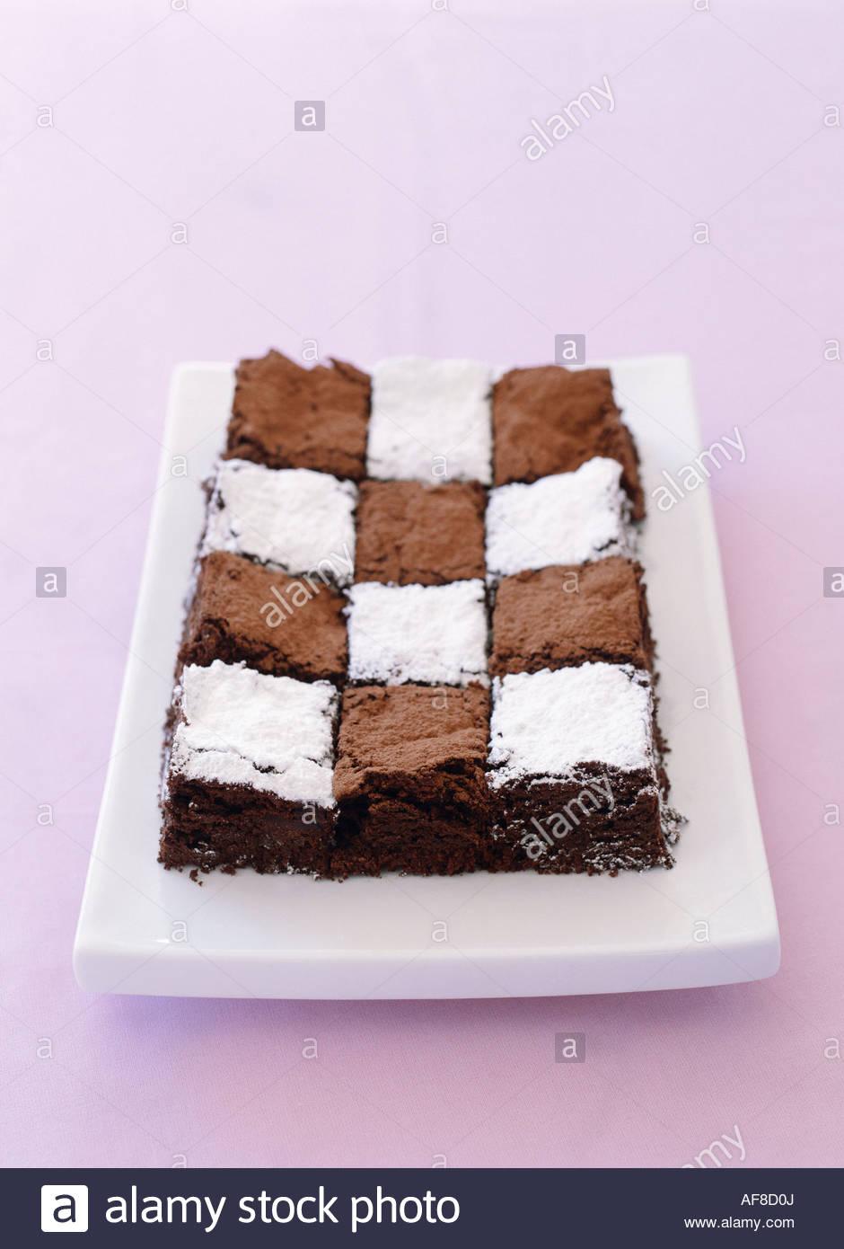 dark sponge cake with chess board design stock photo royalty free