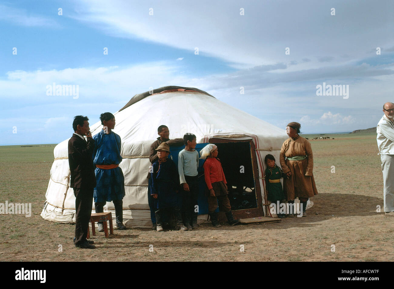 geography / travel Mongolia people family standing in front of round house Asia tent jurt Mongols full length & geography / travel Mongolia people family standing in front of ...