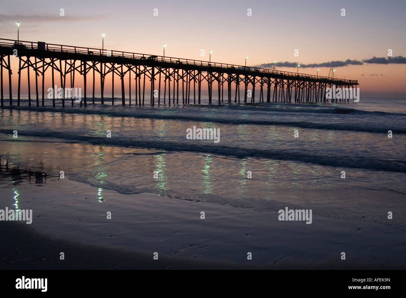 blue lights of carolina beach fishing pier reflected in water at, Reel Combo