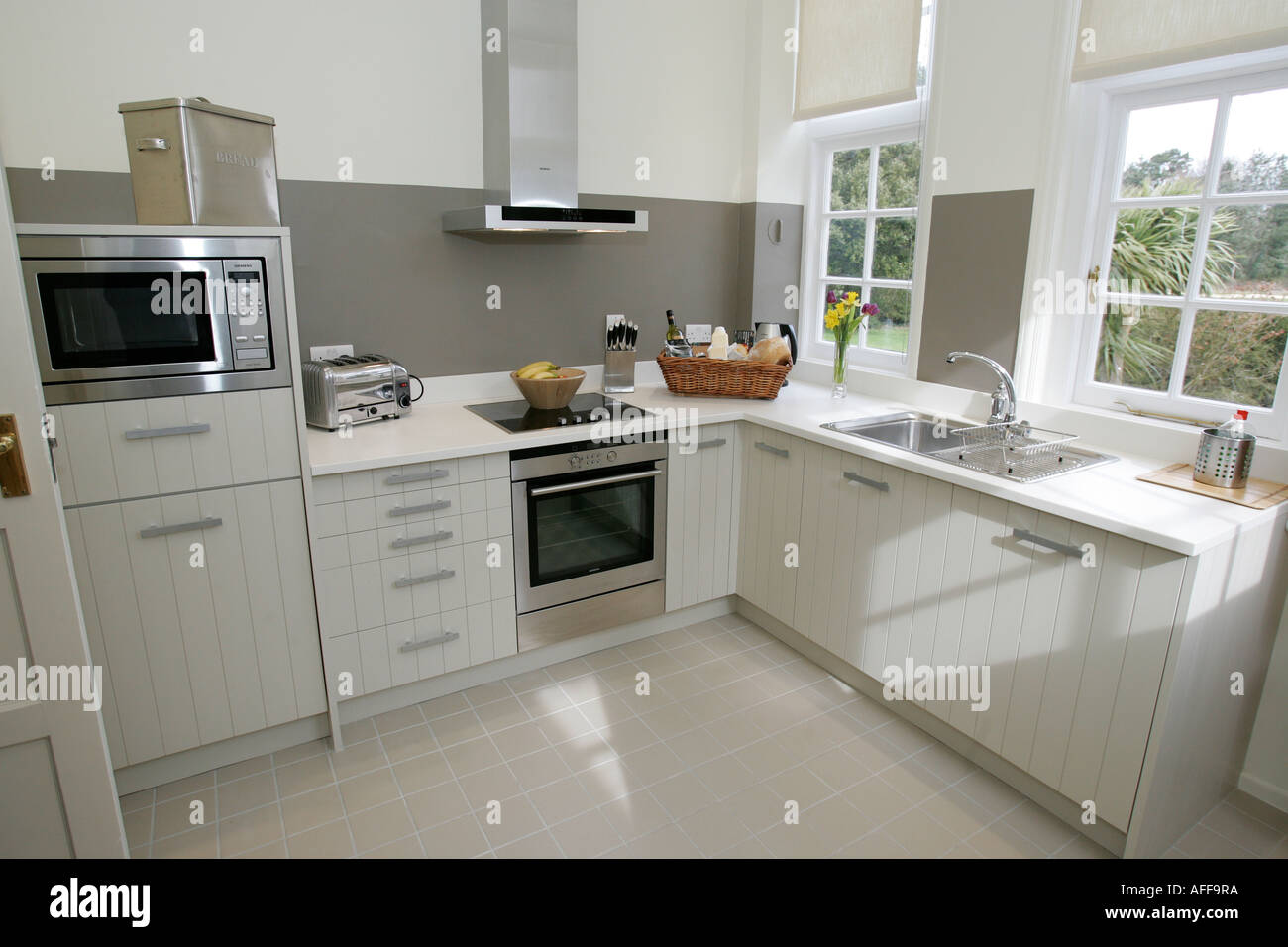 Modern White Shaker Kitchen white kitchen white units stainless stock photos & white kitchen