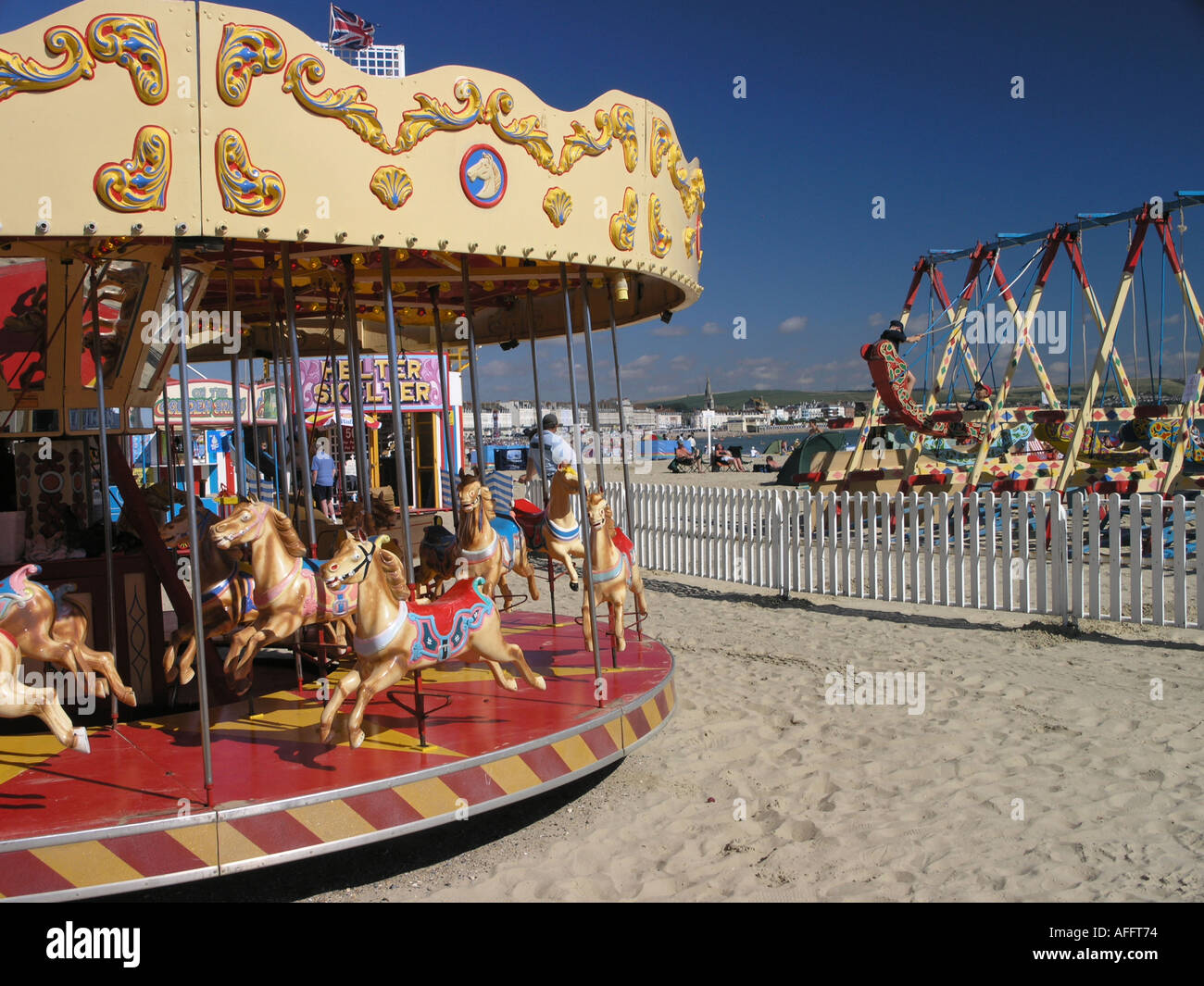 Old fashioned fairground rides on Weymouth beach in Dorset Stock ...