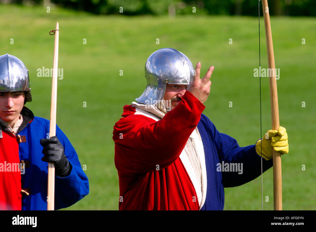 the traditional two fingered archers salute given to the french who were renown for