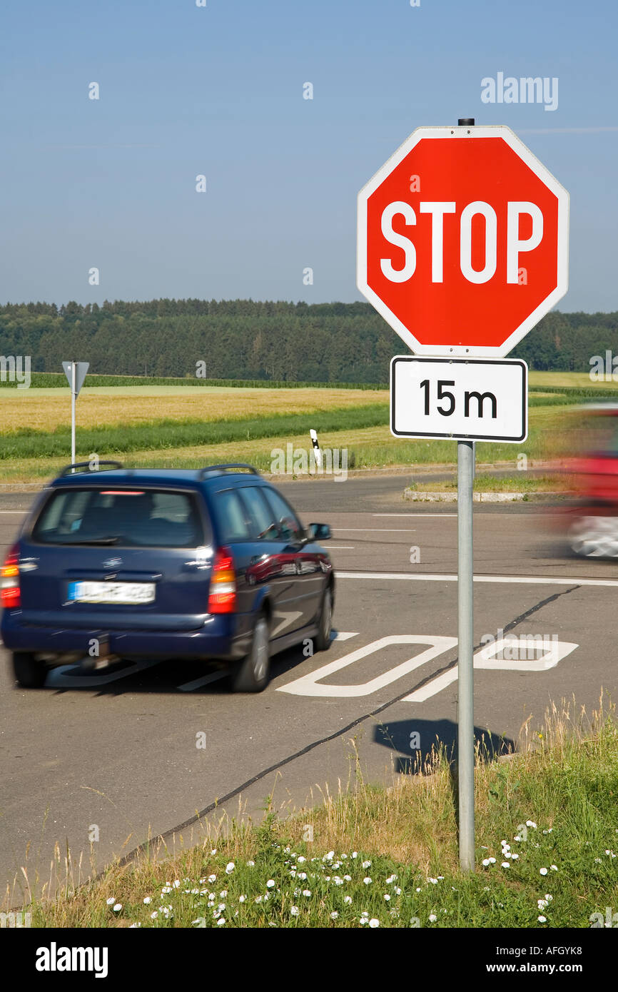 A Car Passes A Crossing With A Stop Sign Another Car Has To Stop