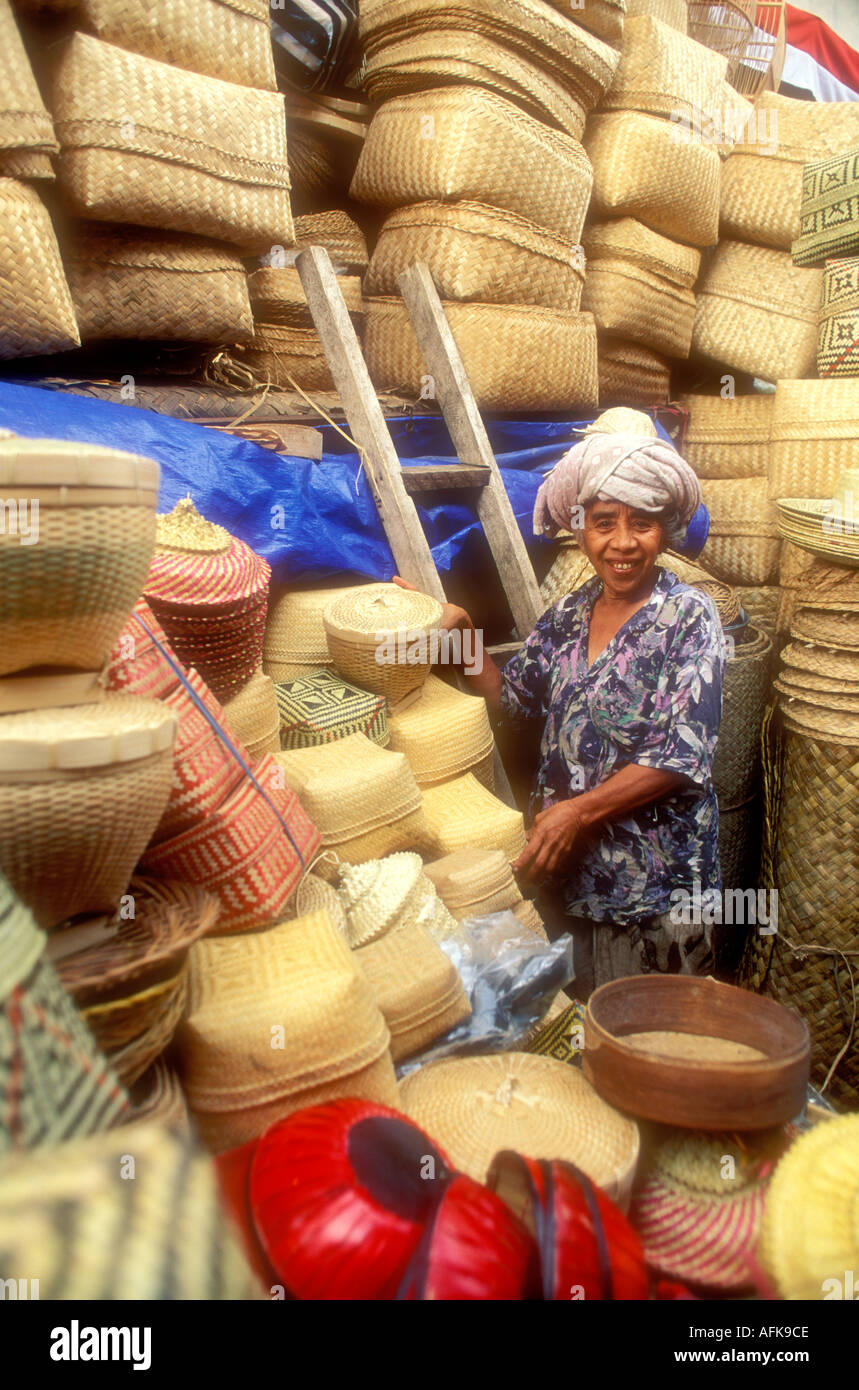 Basket Weaving Ubud : Balinese woman selling baskets in market on the island of