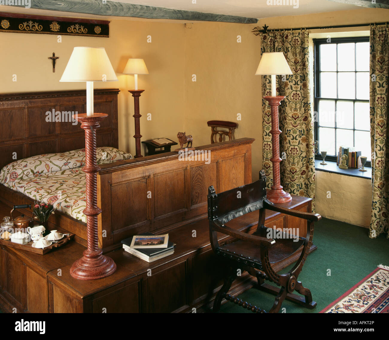 Small Country Bedroom Tall Wooden Lamps On Shelf Around Wooden Bed In Small Country