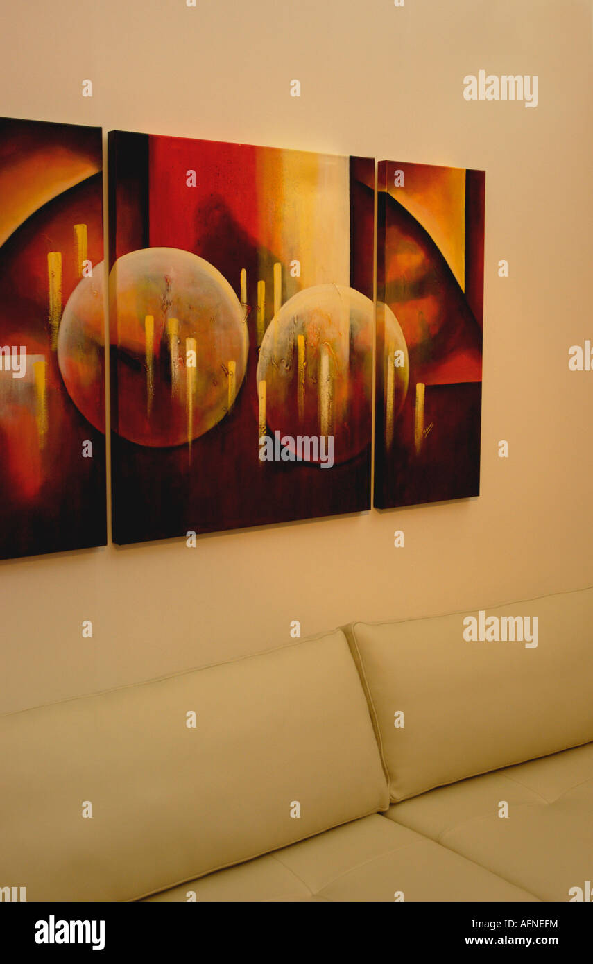 Abstract Painting Above Cream Sofa Cushions In Modern Livingroom