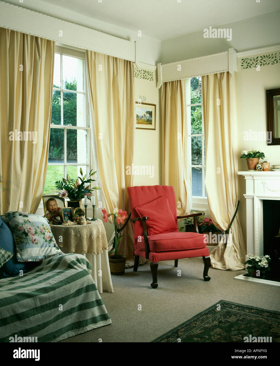 Red Armchair And Cream Curtains With White Wooden Pelmet In Nineties Living Room