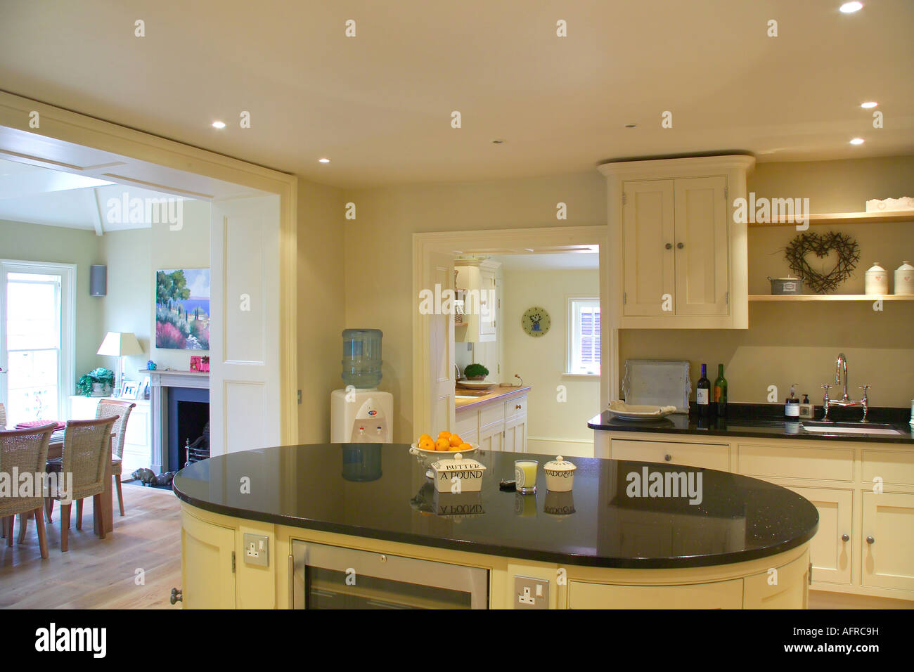 Kitchen Granite Worktop Black Granite Worktop On Oval Island Unit In Modern Cream Kitchen