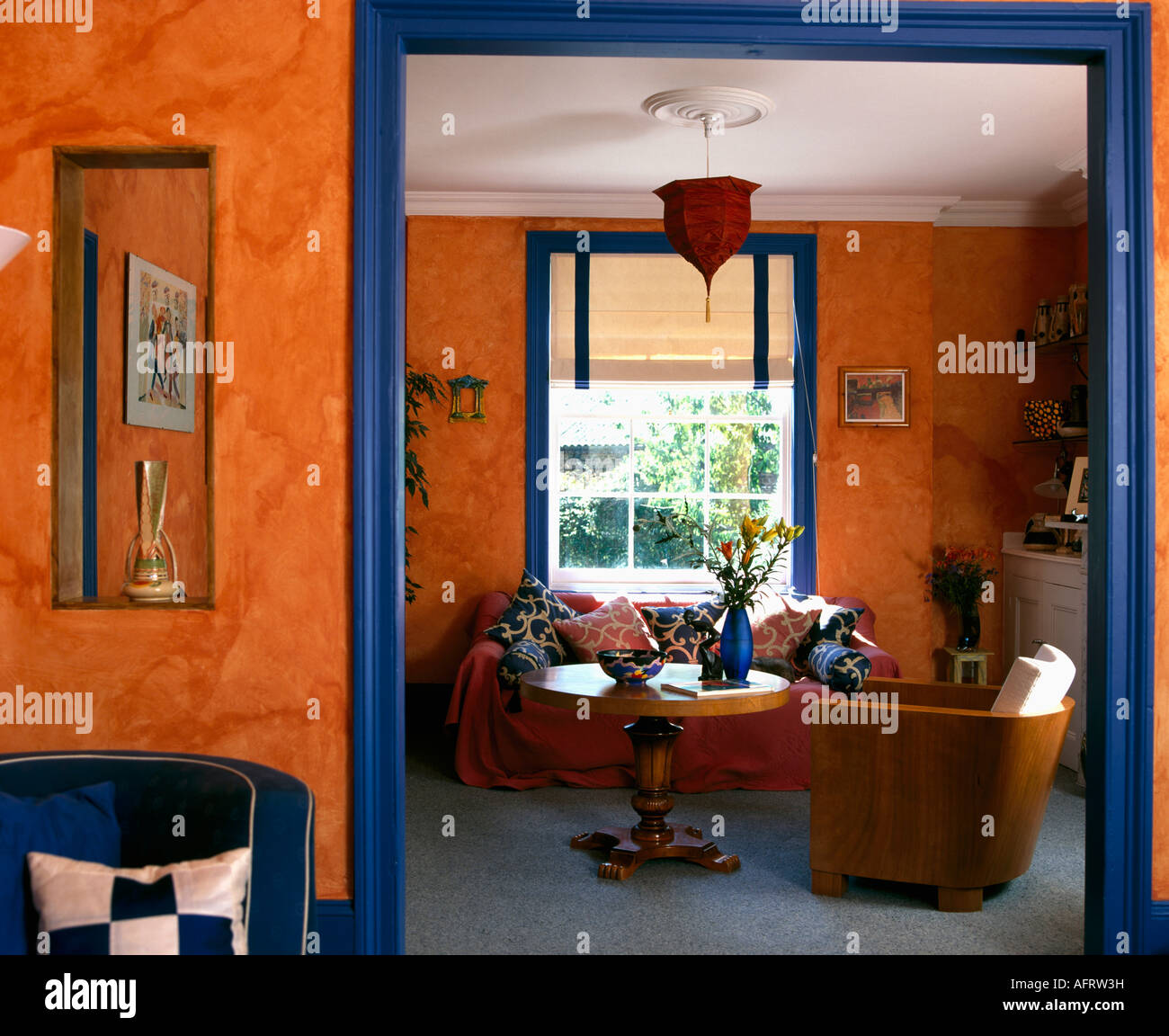 Blue and orange living room - Painted Sponge Effect On Orange Walls Of Living Room With Blue Paintwork Stock Photo