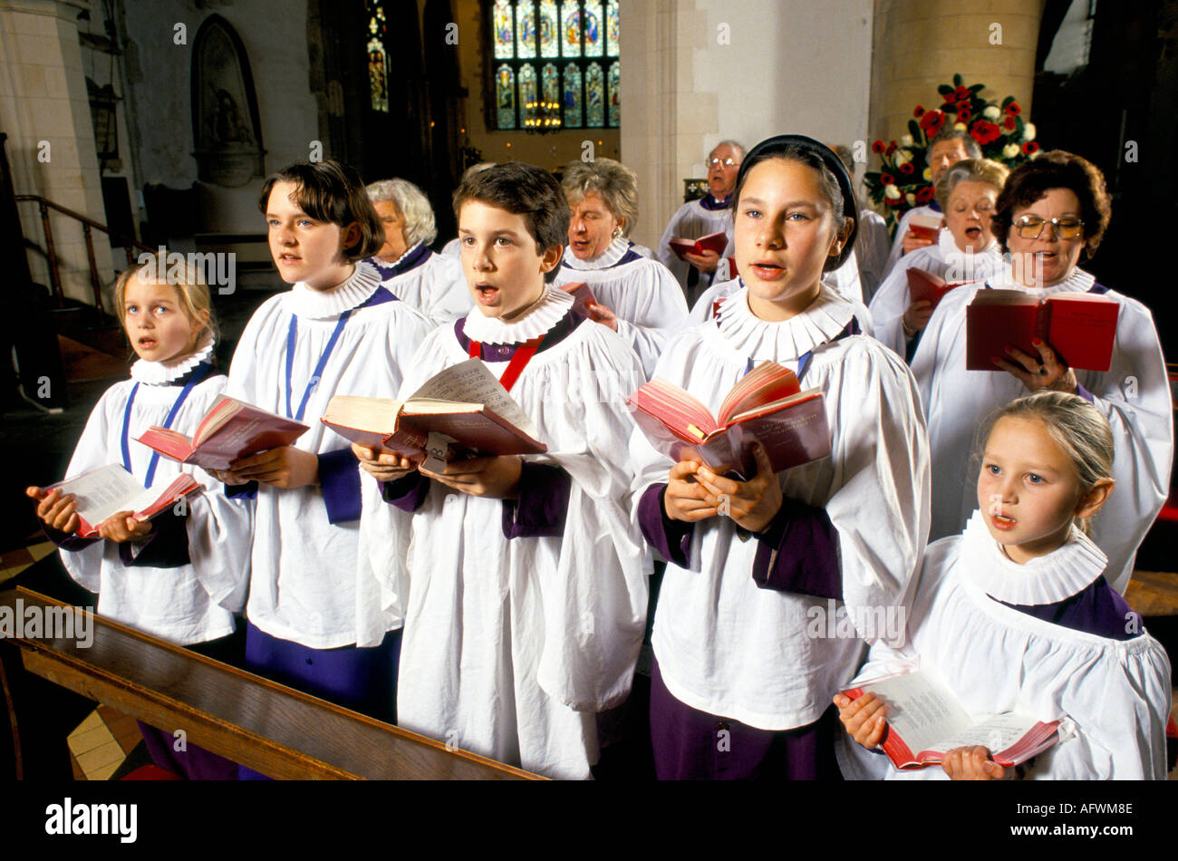 young boy singing in church