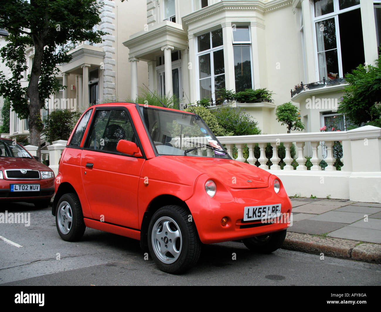 Reva G Wiz Electric Car On A London Street In The Uk Stock Photo