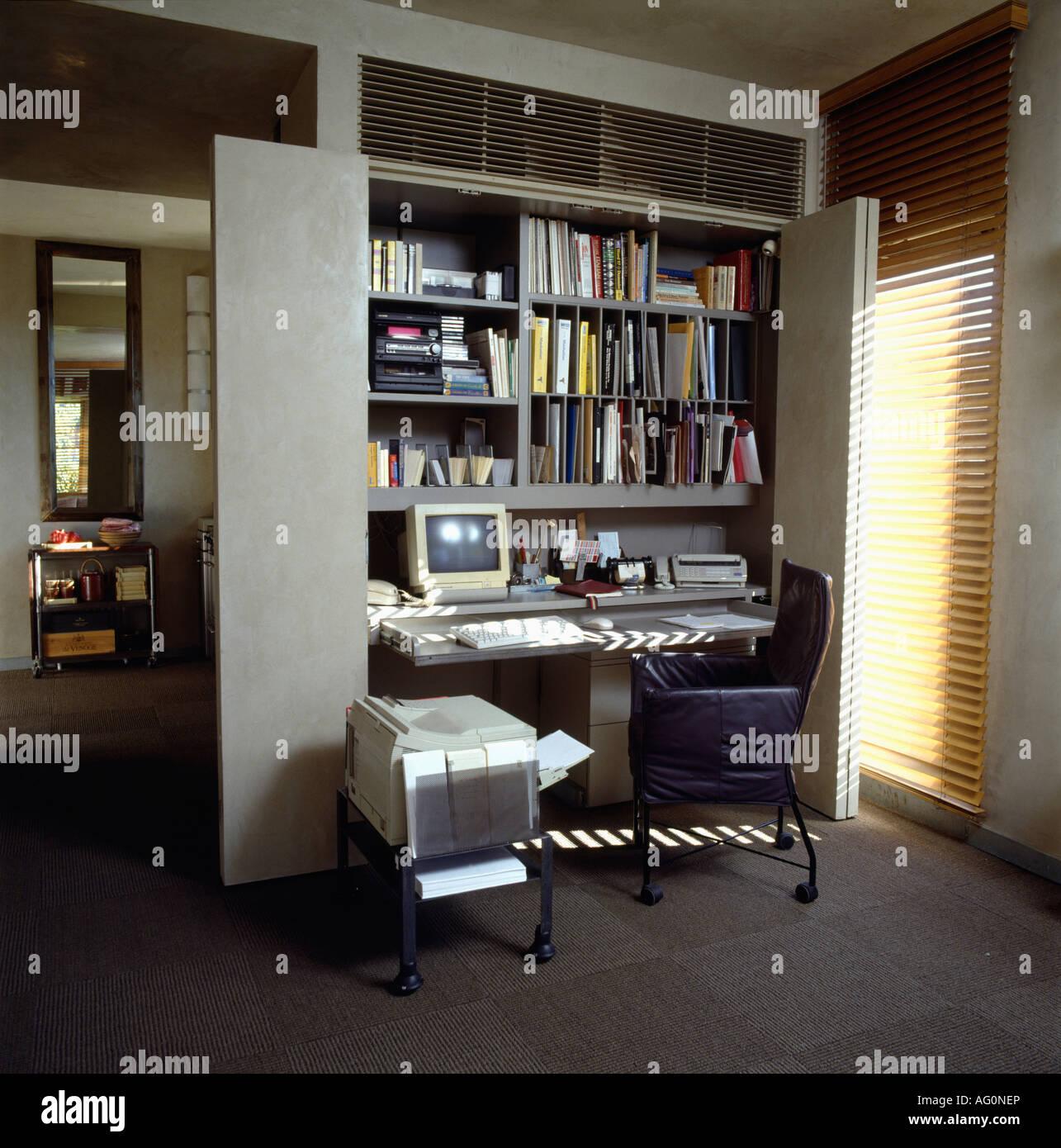 fold away office desk. computer on desk below shelving in modern gray foldaway homeoffice fold away office d