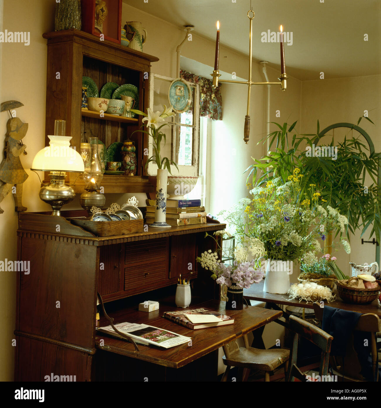 stock photo victorian style lamp on antique desk in study dining room with candles and fresh flowers