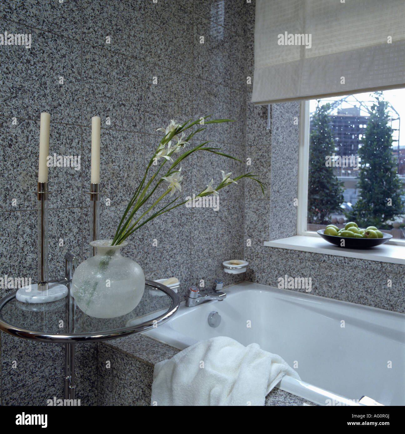 Tall candlesticks and circular glass vase on eileen gray chrome tall candlesticks and circular glass vase on eileen gray chrome glass modern bathroom designed by mary fox linton reviewsmspy