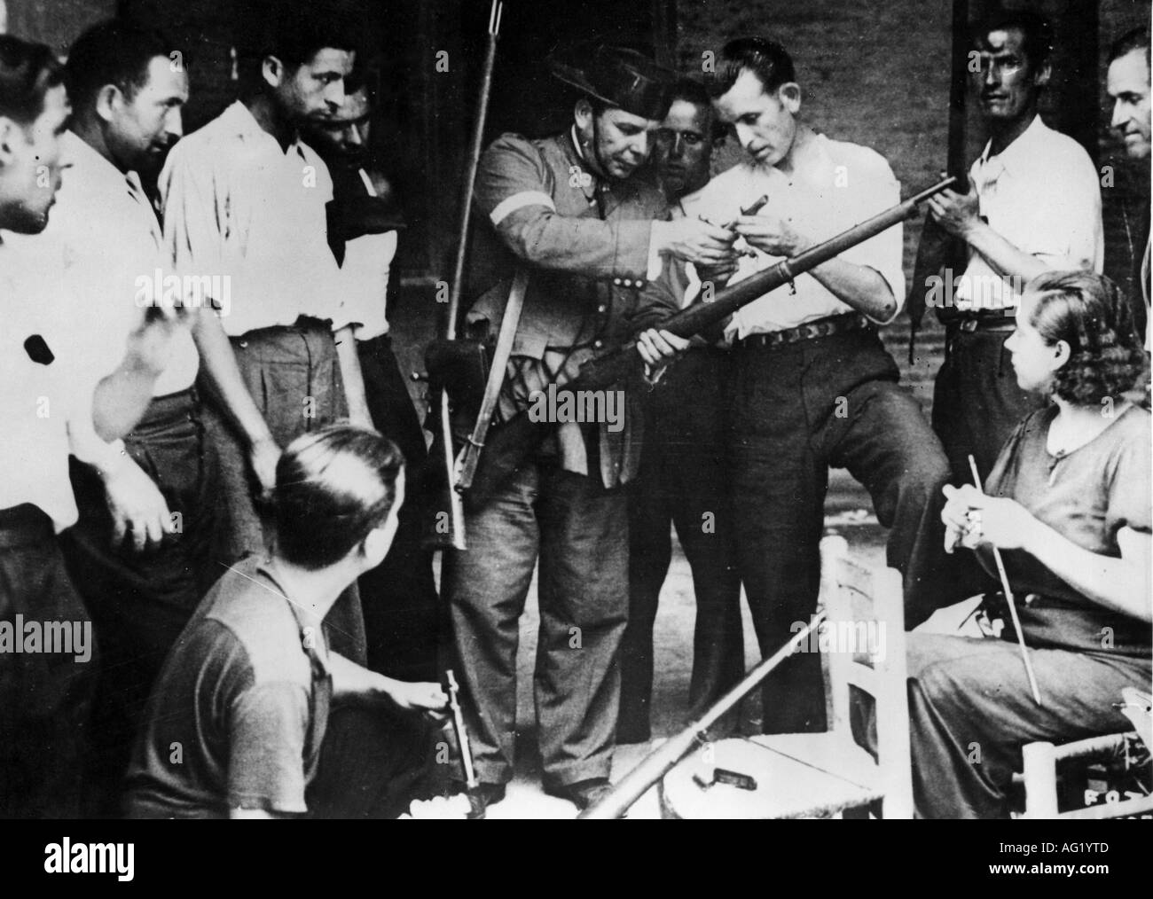 Geography travel spain civil war 1936 1939 member of the guardia civil gives rifle instruction for the militia 1936 poli