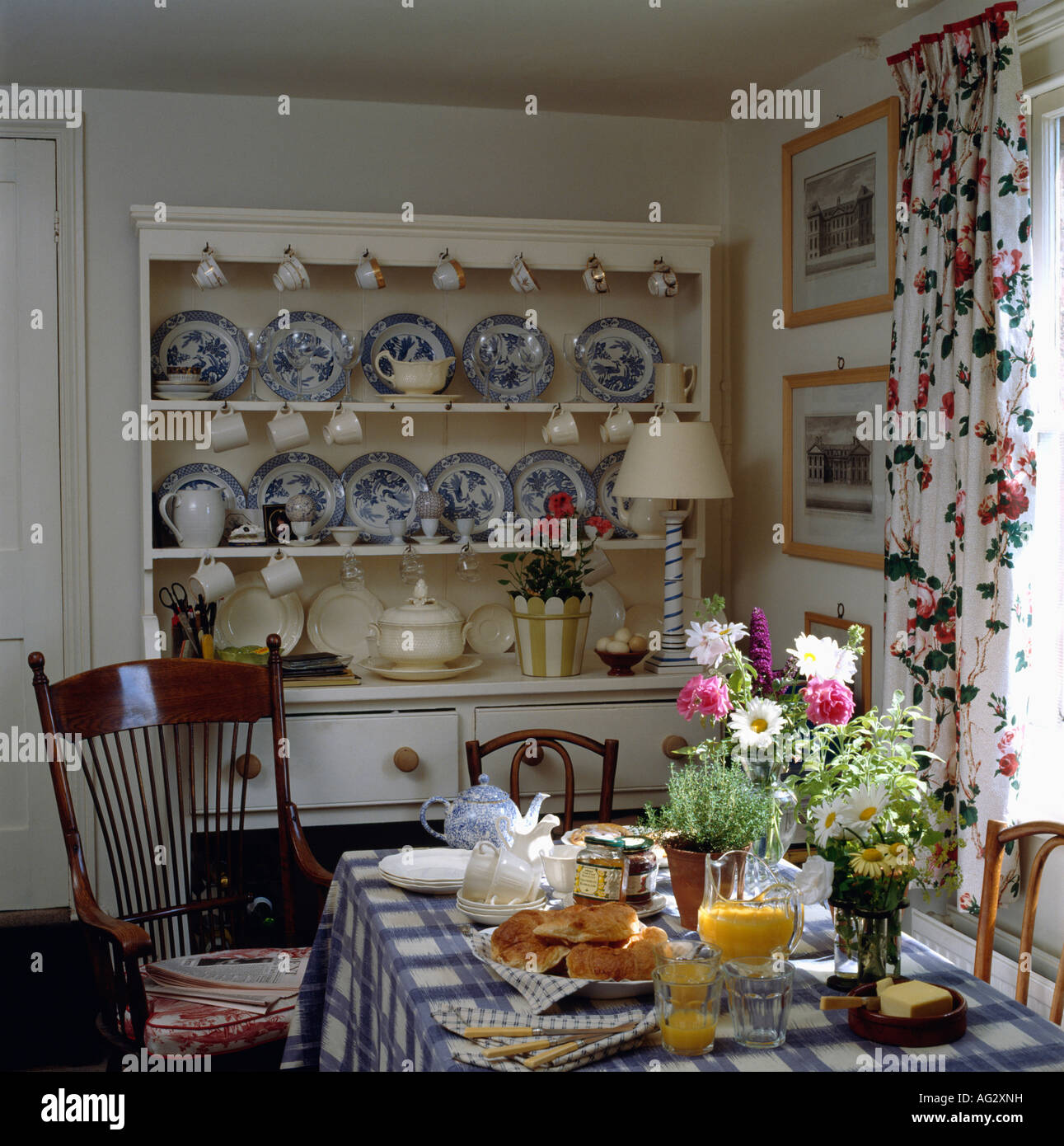 Blue White China On Dresser In Country Dining Room With Floral Drapes And Fresh