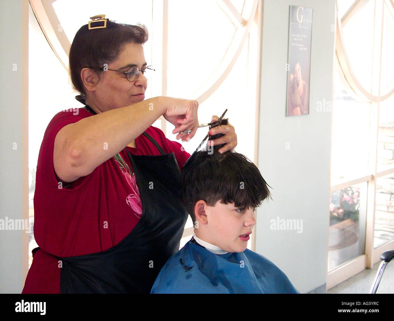 Teen White Boy Gets Haircut By Female Barber Usa Stock