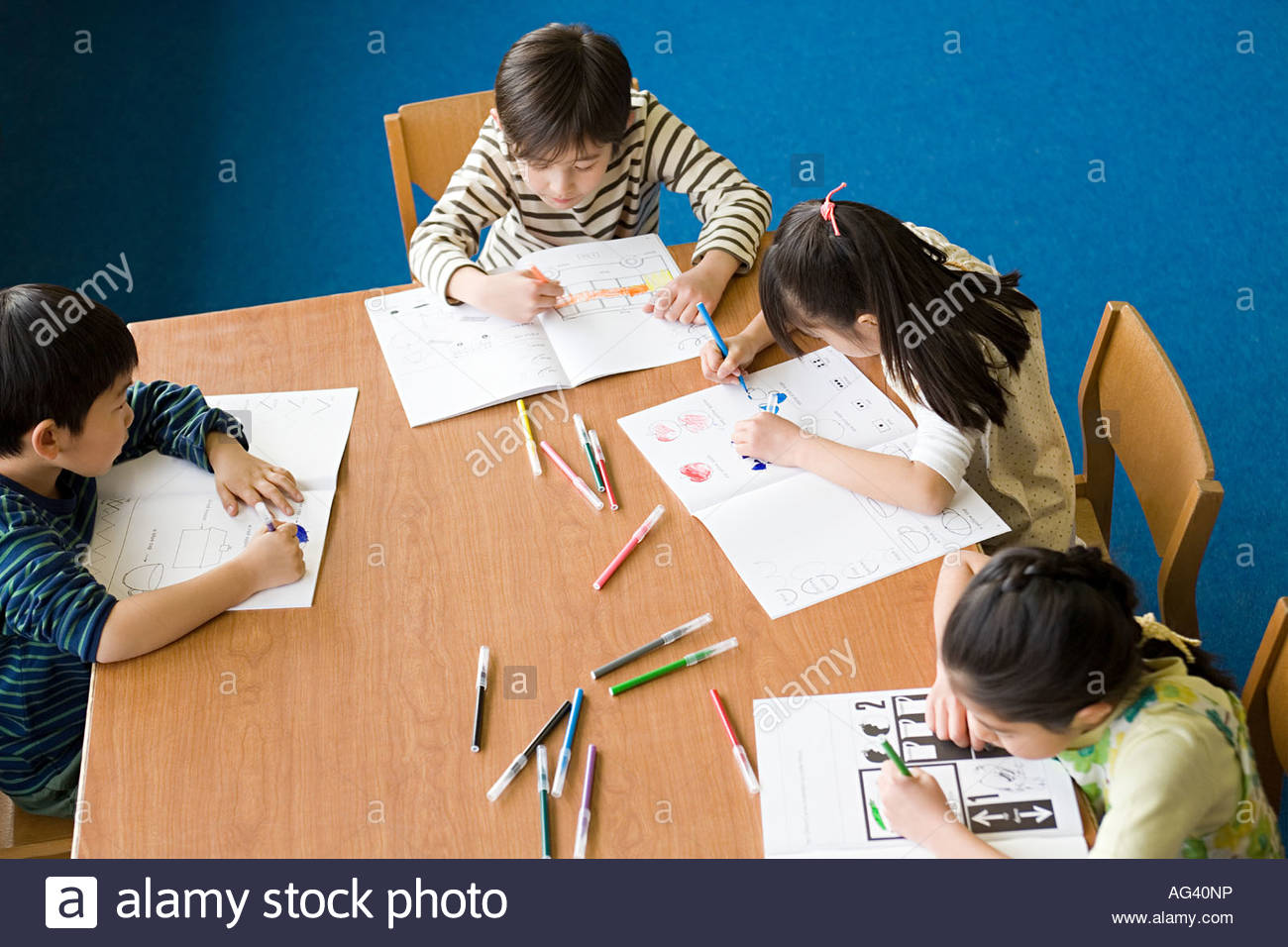 School children colouring in Stock Photo Royalty Free Image