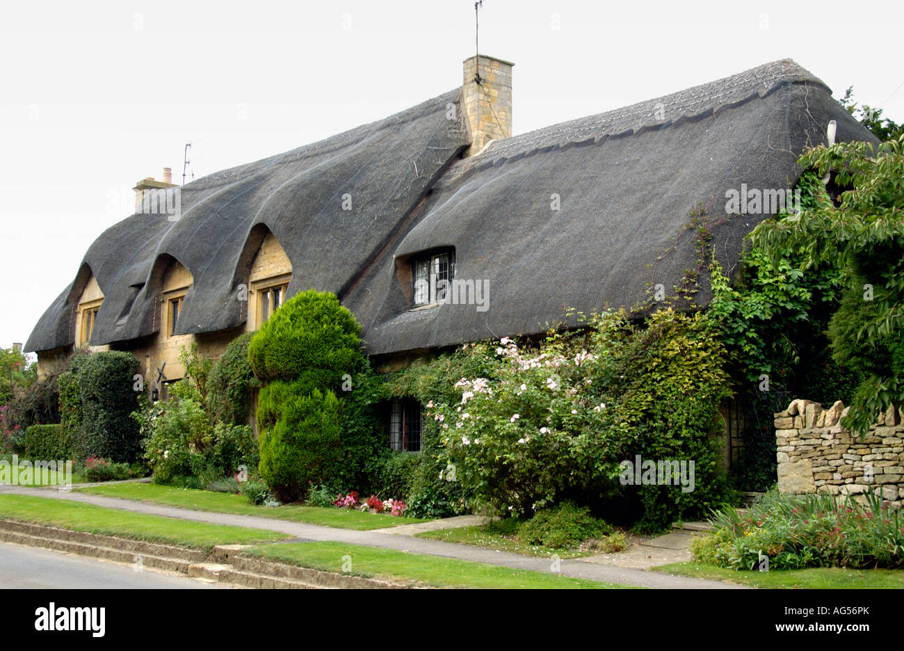 Thatched Roof Cottage In Pretty Cotswold Village Of