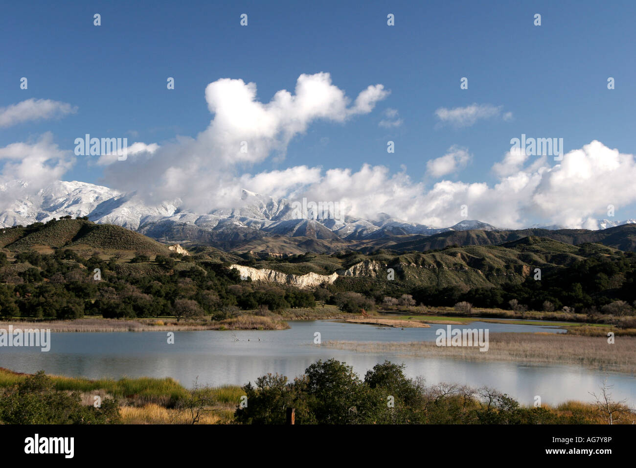 View of cachuma lake with snow covered peaks in the for Cachuma lake fishing