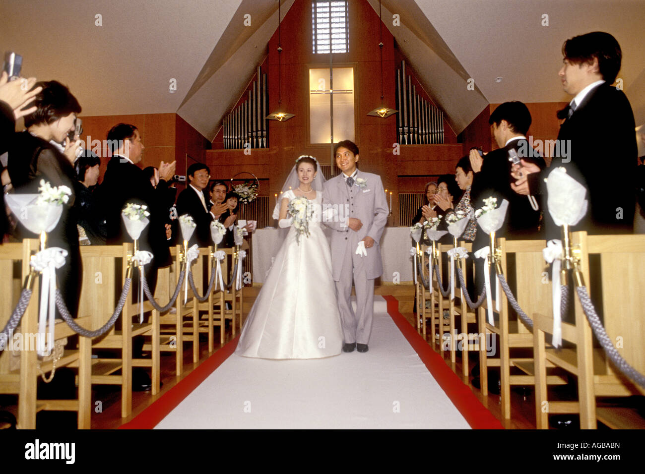 Japanese wedding blessings - A Japanese Wedding Couple In Catholic Church Within A Hotel Wearing Traditional Western Style Wedding Dress