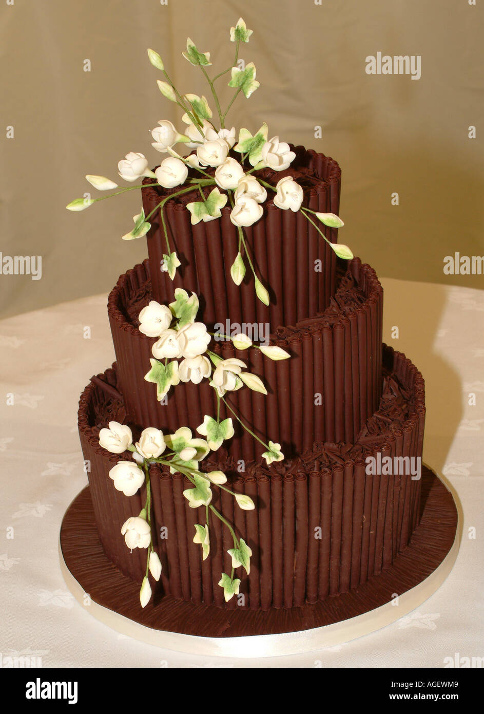 Tiered Chocolate Wedding Cake Decorated With White Edible