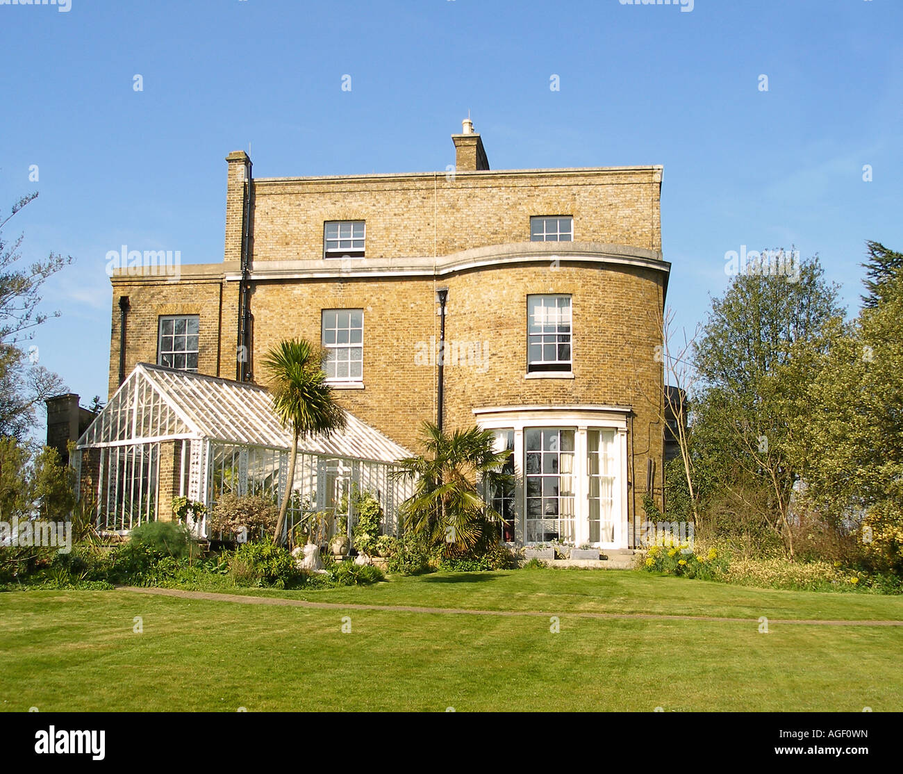Typical english country house and garden stock photo for Country house online