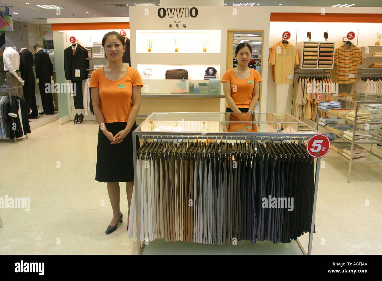 shanghai s assistant at a clothes shop stock photo shanghai s assistant at a clothes shop