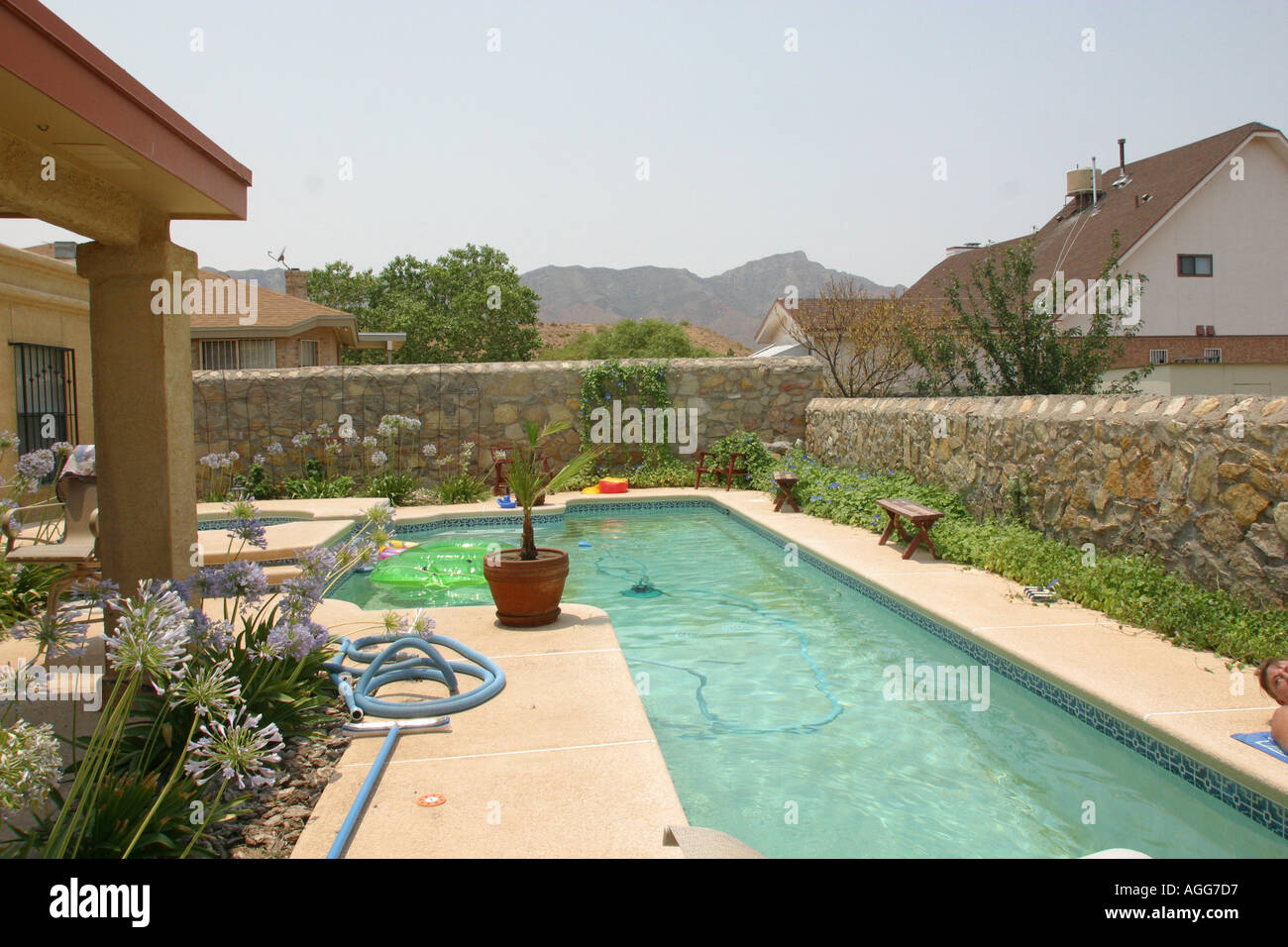 Outdoor pool in el paso texas with mountains in background for Pool design el paso tx