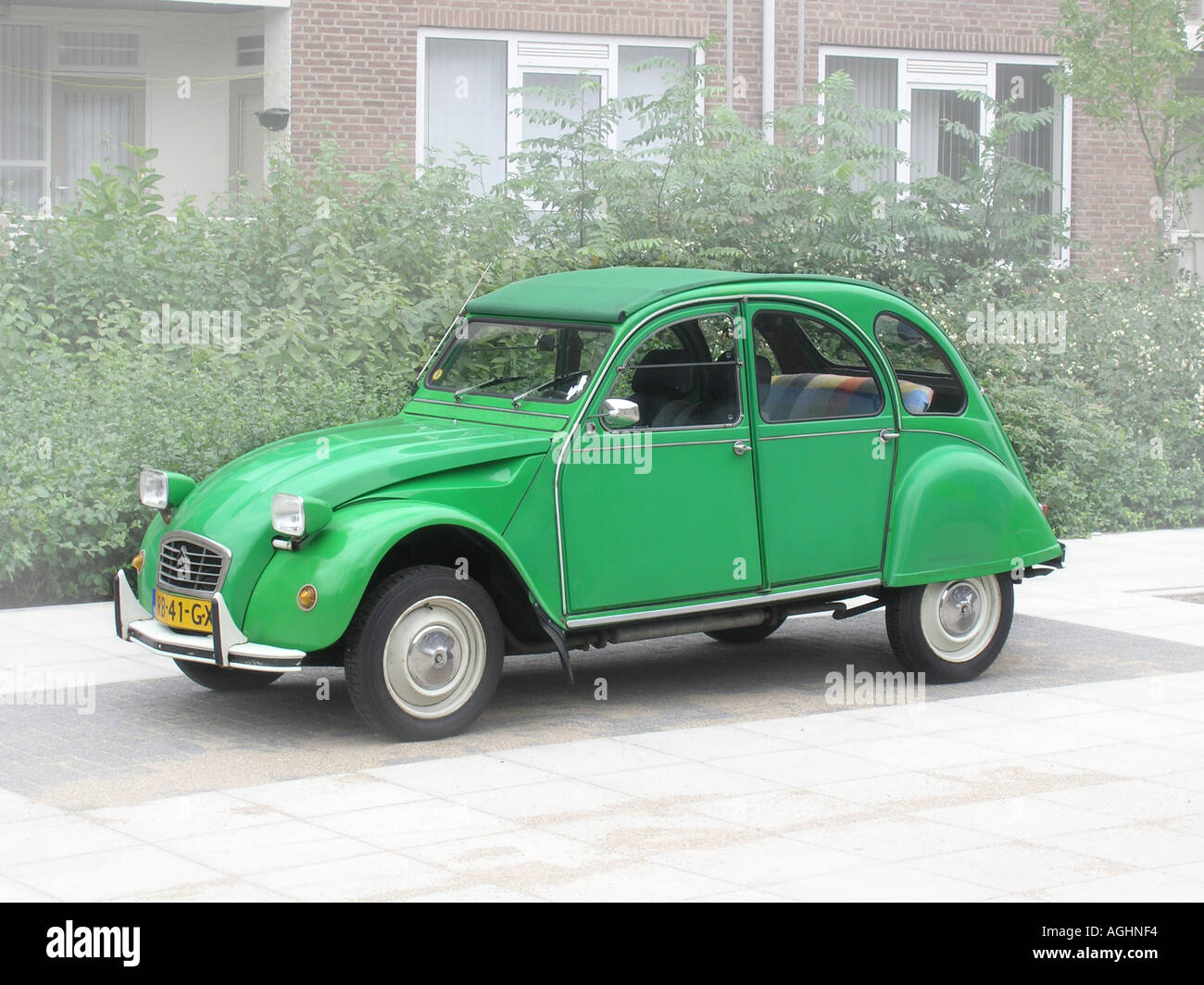 green citroen deux chevaux parked by roadside stock photo royalty free image 4641267 alamy. Black Bedroom Furniture Sets. Home Design Ideas